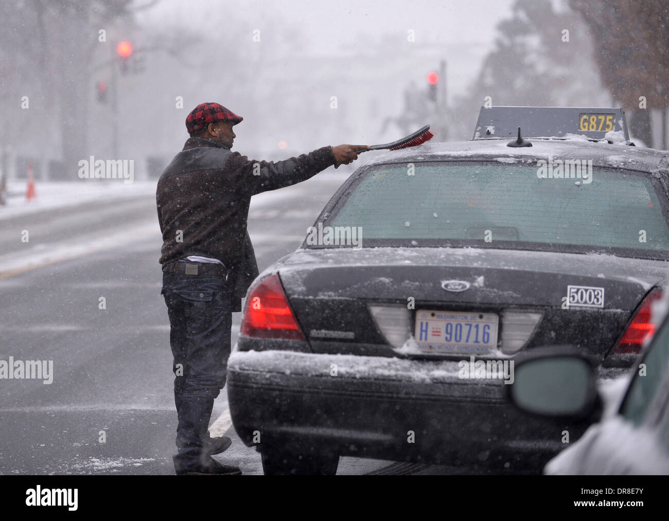A Taxi Driver Cleans Snow Off His Car Near The White House In Washington Dc Capital Of The United States Jan