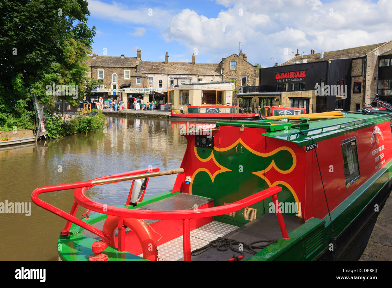 Narrowboats moored by wharf at Leeds and Liverpool Canal Basin Skipton in Craven North Yorkshire England - Stock Image