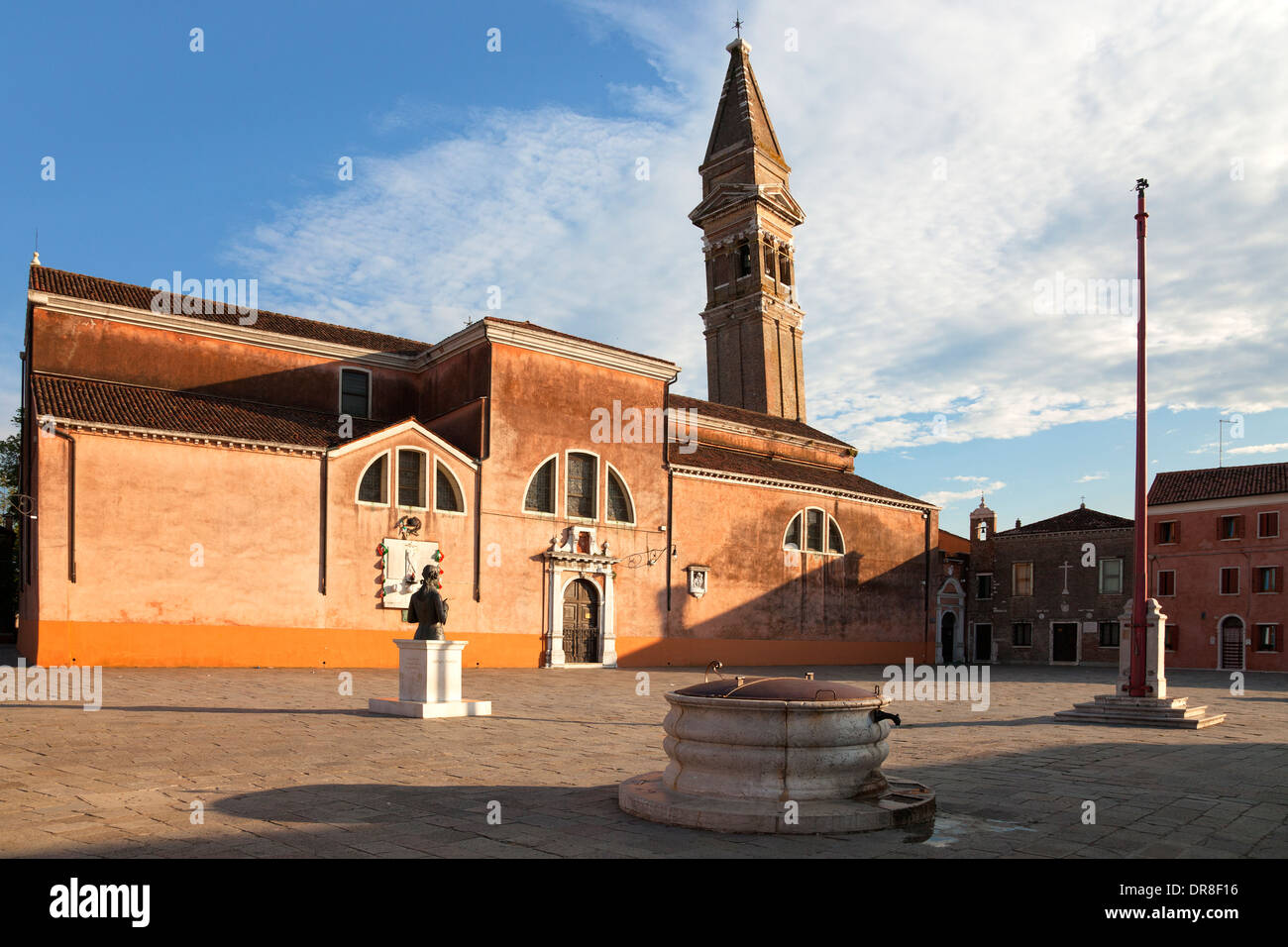 Burano, Venice - Piazza Baldassare Galuppi and tilting tower of the church San Martini on Burano, Italy; Chiesa di San Martini - Stock Image