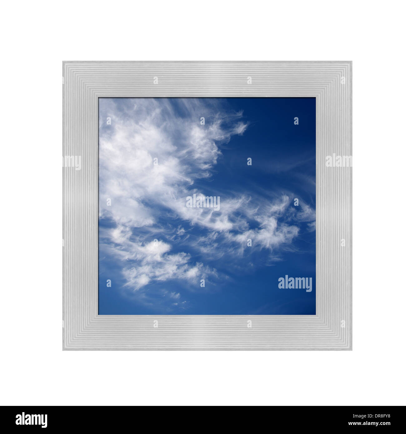 A contrasty blue cloudy sky photographed during the day - Stock Image