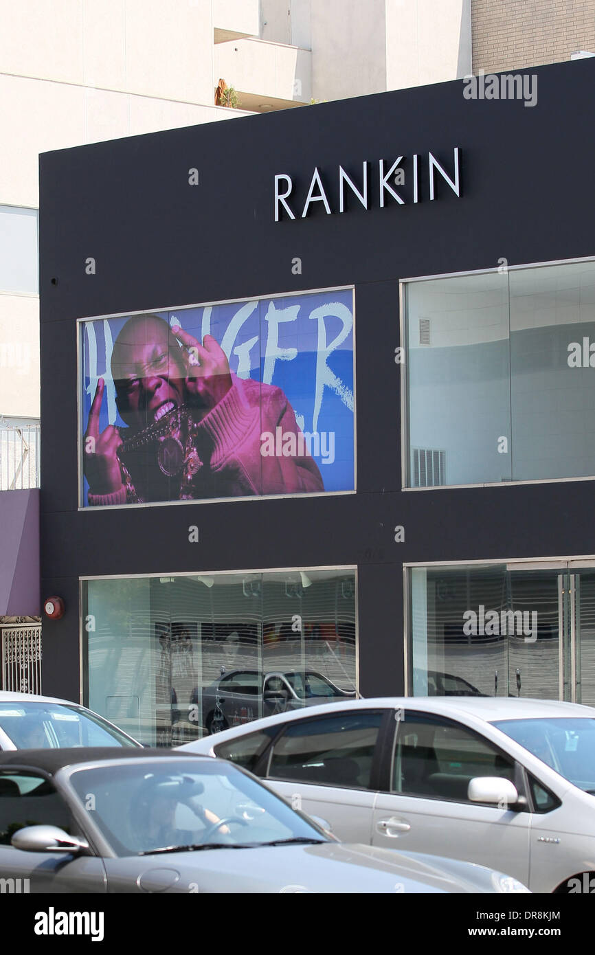 A large window display featuring a photograph of British rapper Dizzee Rascal laughing and 'flipping a double bird' is displayed on the facade of photographer Rankin's gallery on Los Angeles' Melrose Avenue. The image was shot for Rankin's magazine Hunger. Los Angeles, California - 19.06.12 - Stock Image