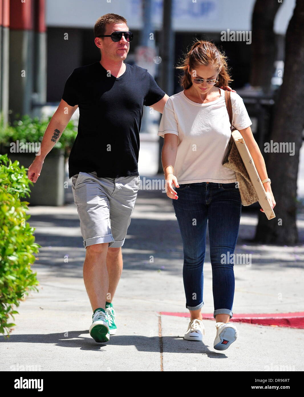 Minka Kelly seen out and about with a male companion holding