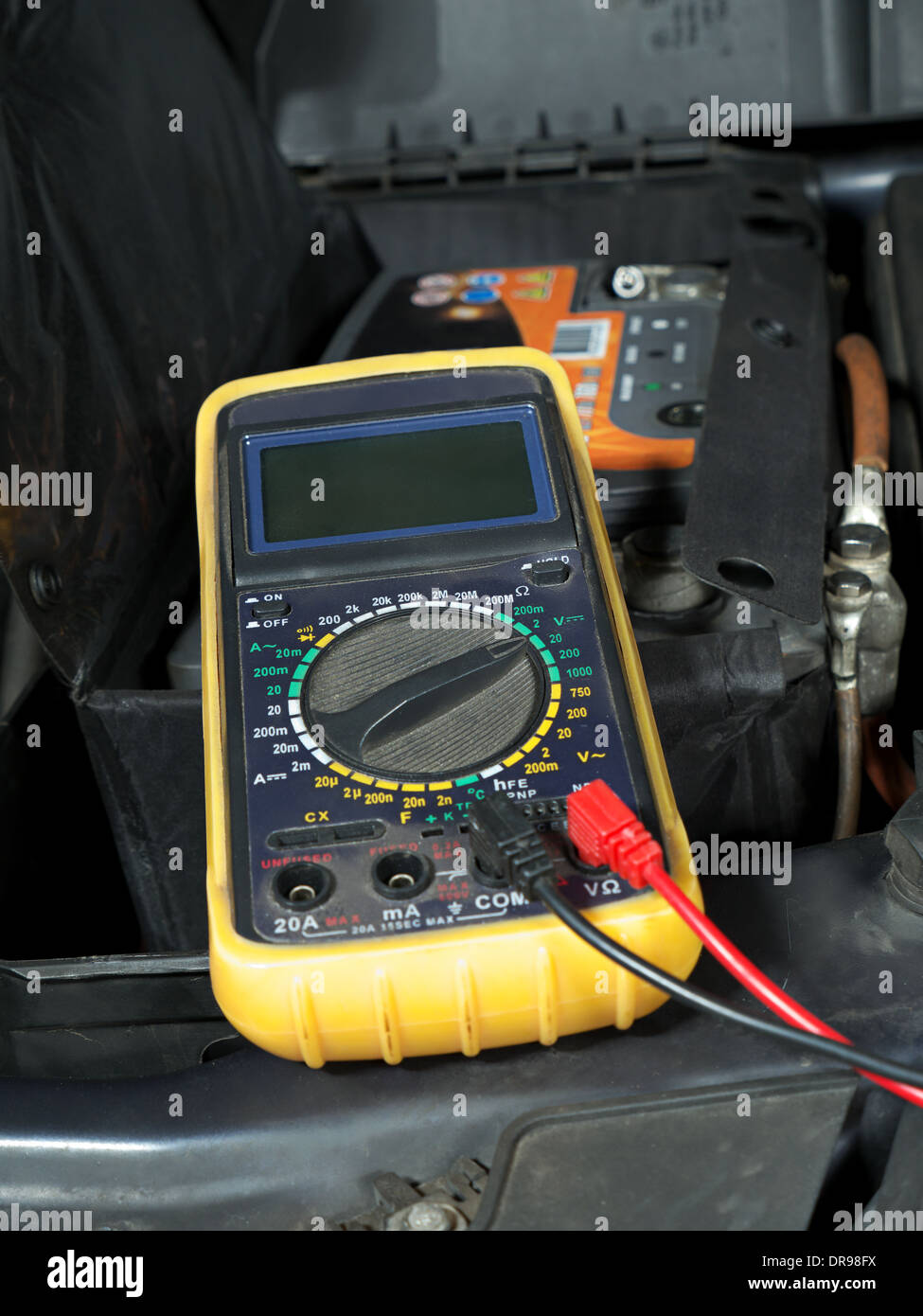 Multimeter set up and ready for taking car battery voltage measurement - Stock Image