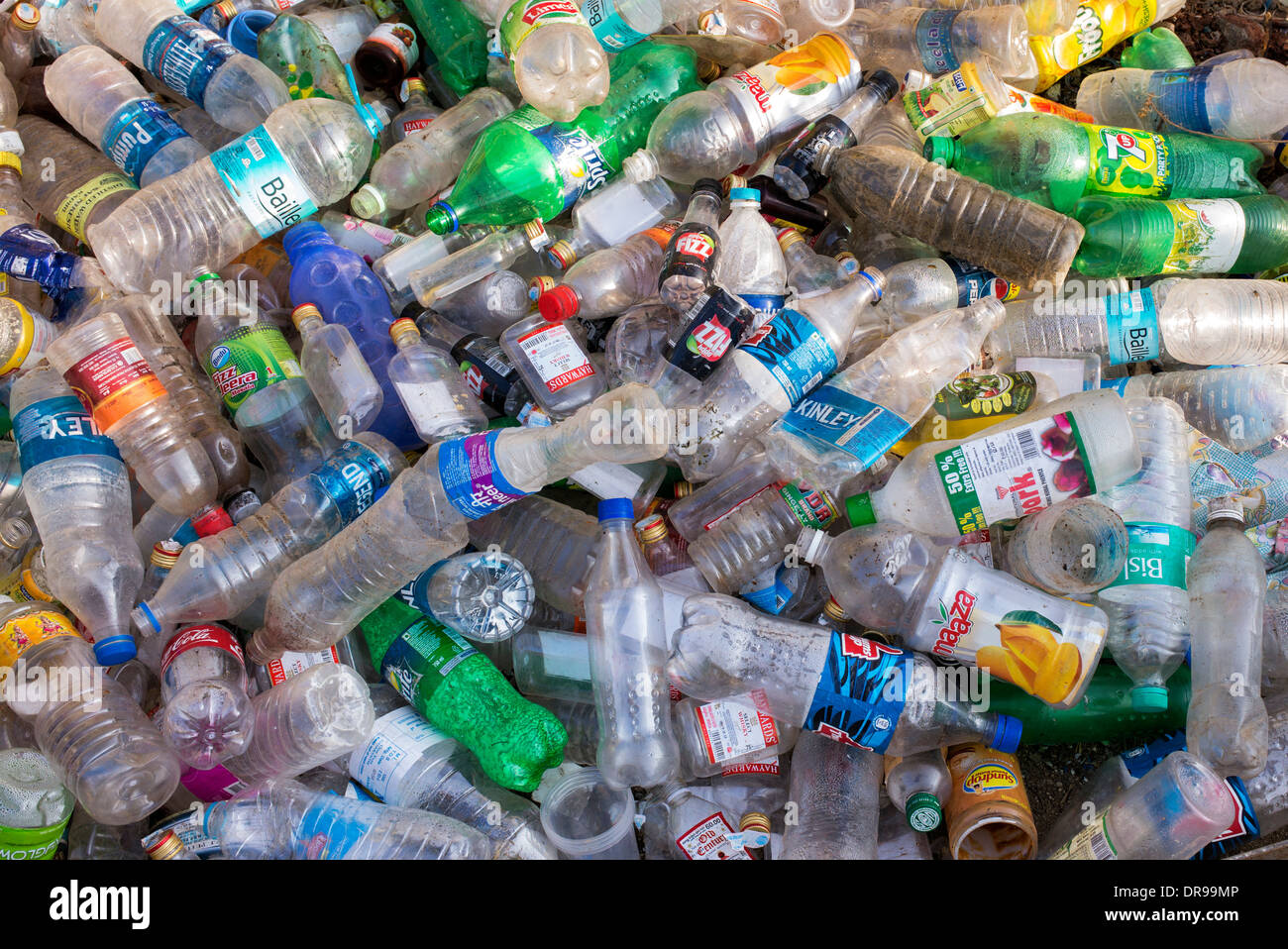 Empty Plastic drinking bottles dumped for recycling in India - Stock Image
