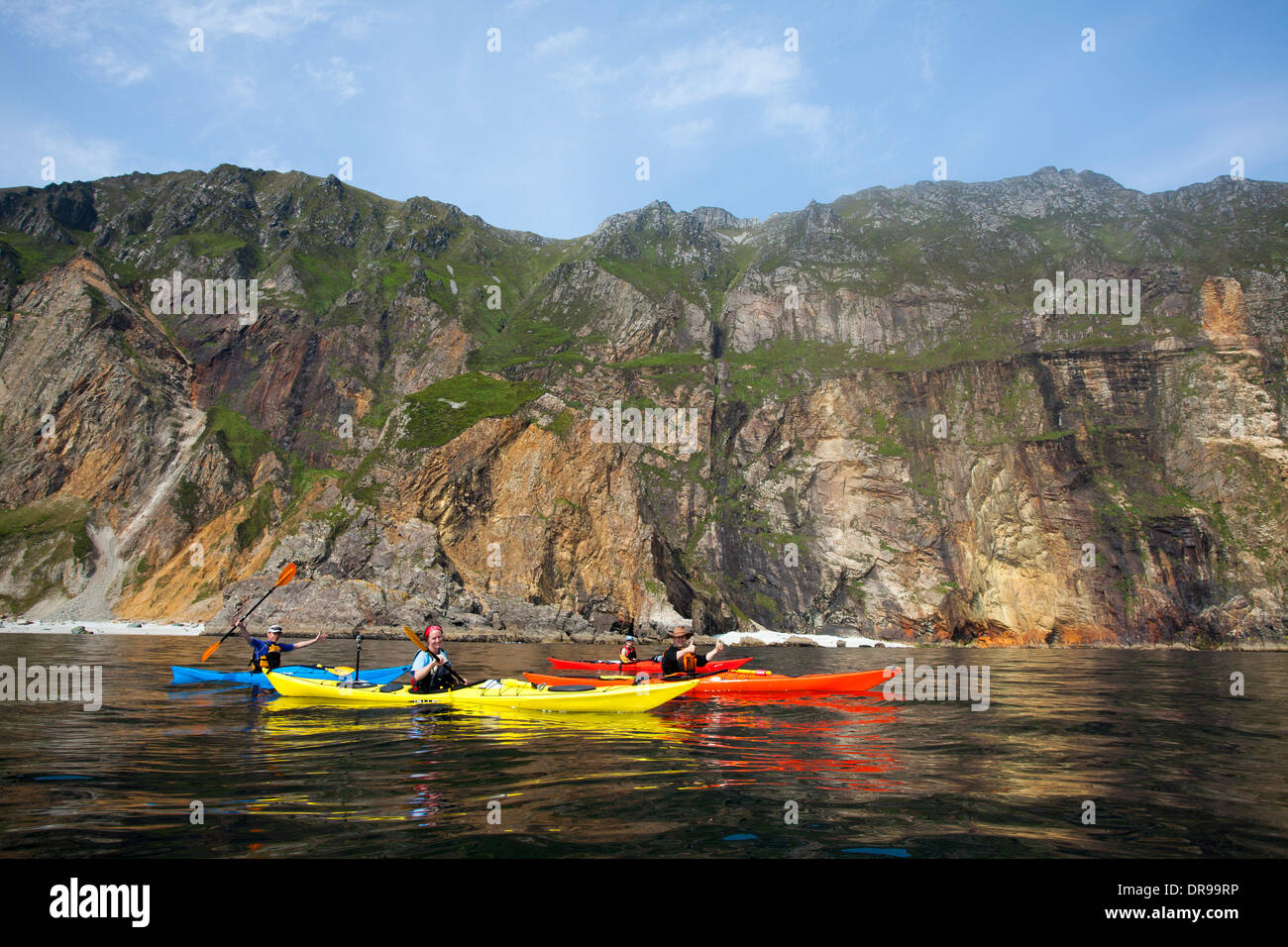 Sea kayaking beneath the Slieve League cliffs, County Donegal, Ireland. - Stock Image