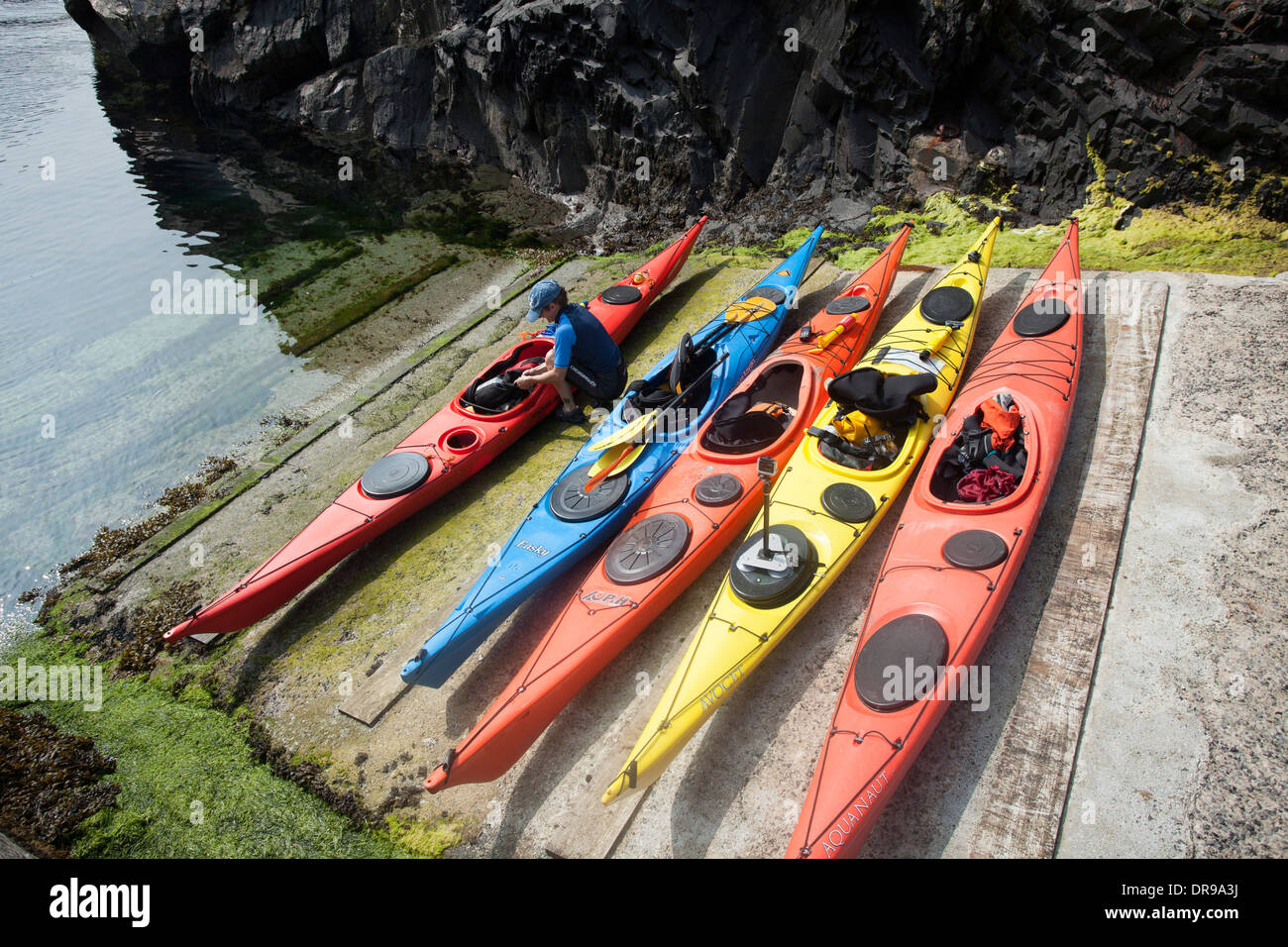 Sea kayaks on the slipway at Malin Beg, County Donegal, Ireland. - Stock Image