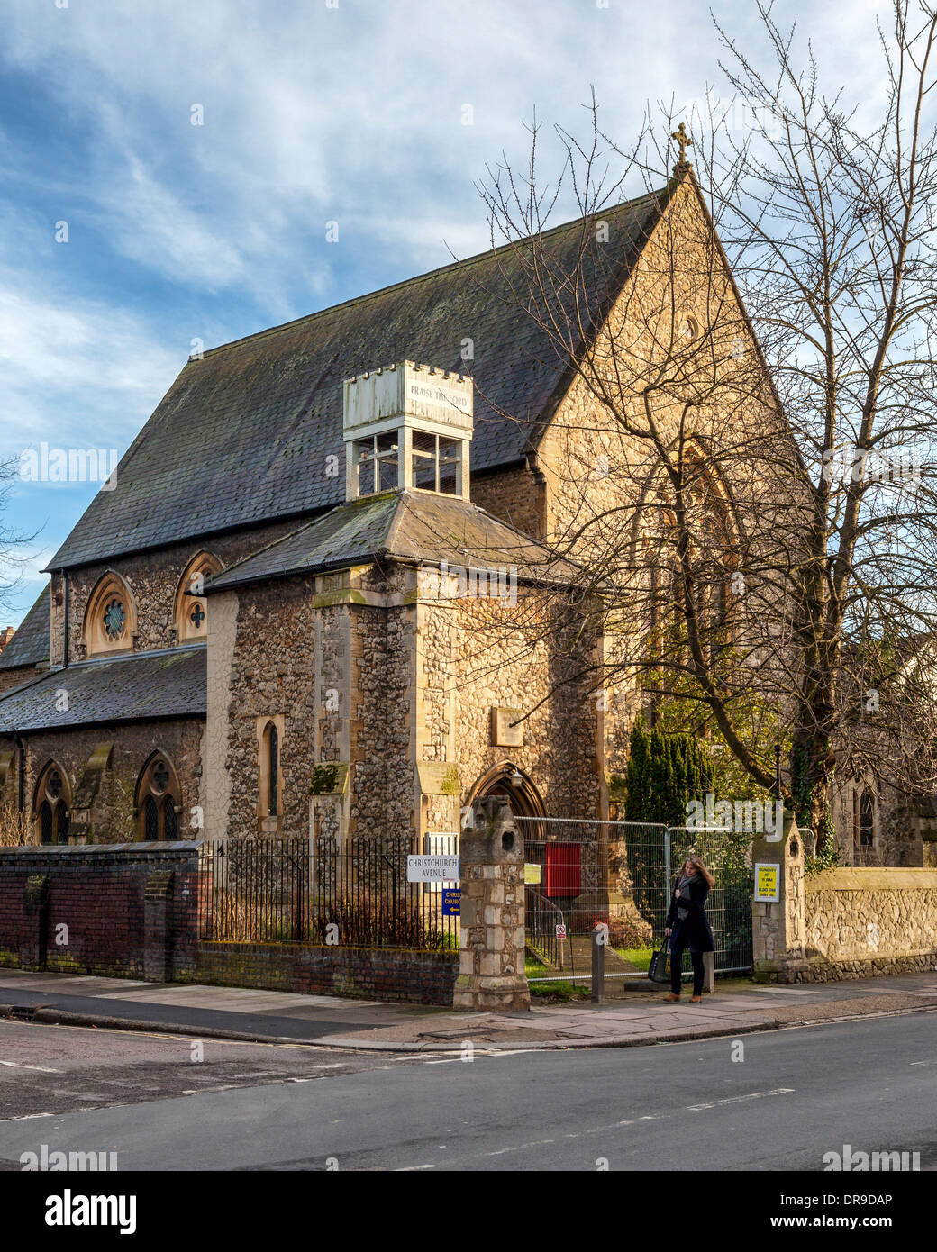 Christ Church stone building with turret and cross - structure is unsafe, dangerous and not in use Teddington Stock Photo