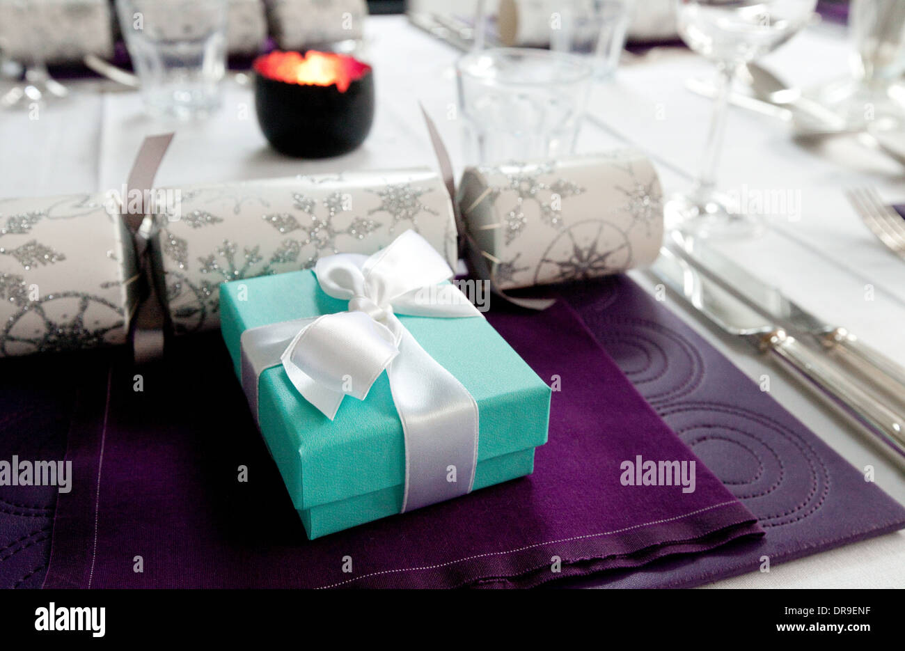Christmas table present presents at the dinner place setting, UK - Stock Image