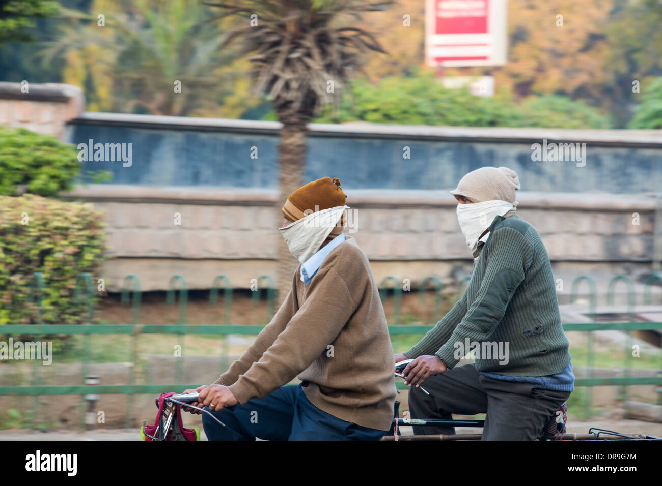Cyclists wearing face mask to counter the terrible air pollution in Ahmedabad; India; - Stock Image