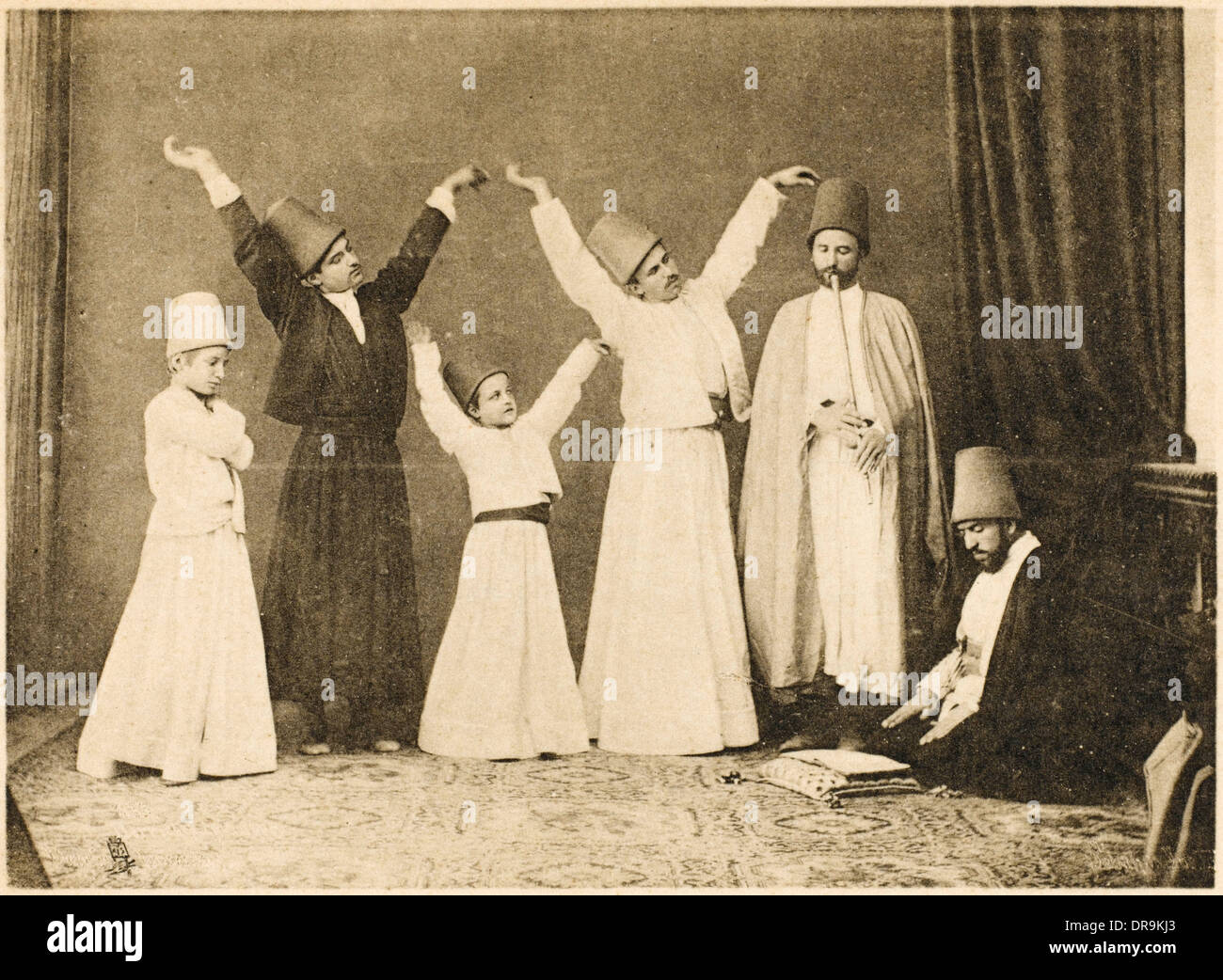 Whirling Dervishes - young and old - Stock Image