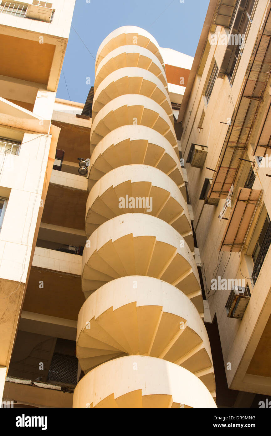 An apartment block with a spiral staircase fire escape in Ahmedabad; India; - Stock Image
