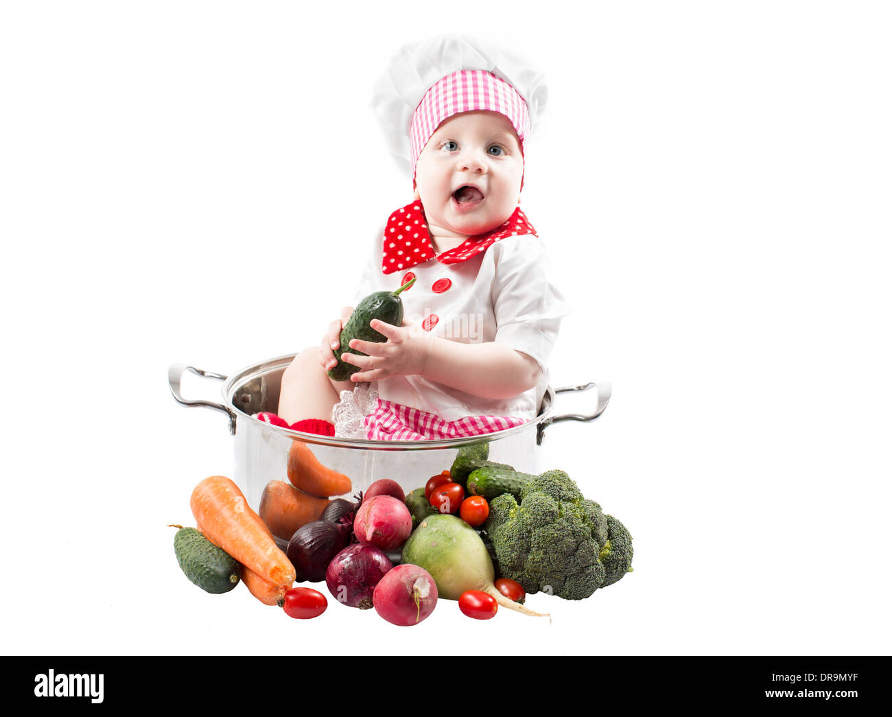 0ed0f9c8b8c Baby cook girl wearing chef hat with fresh vegetables and fruits. Use it for  a child