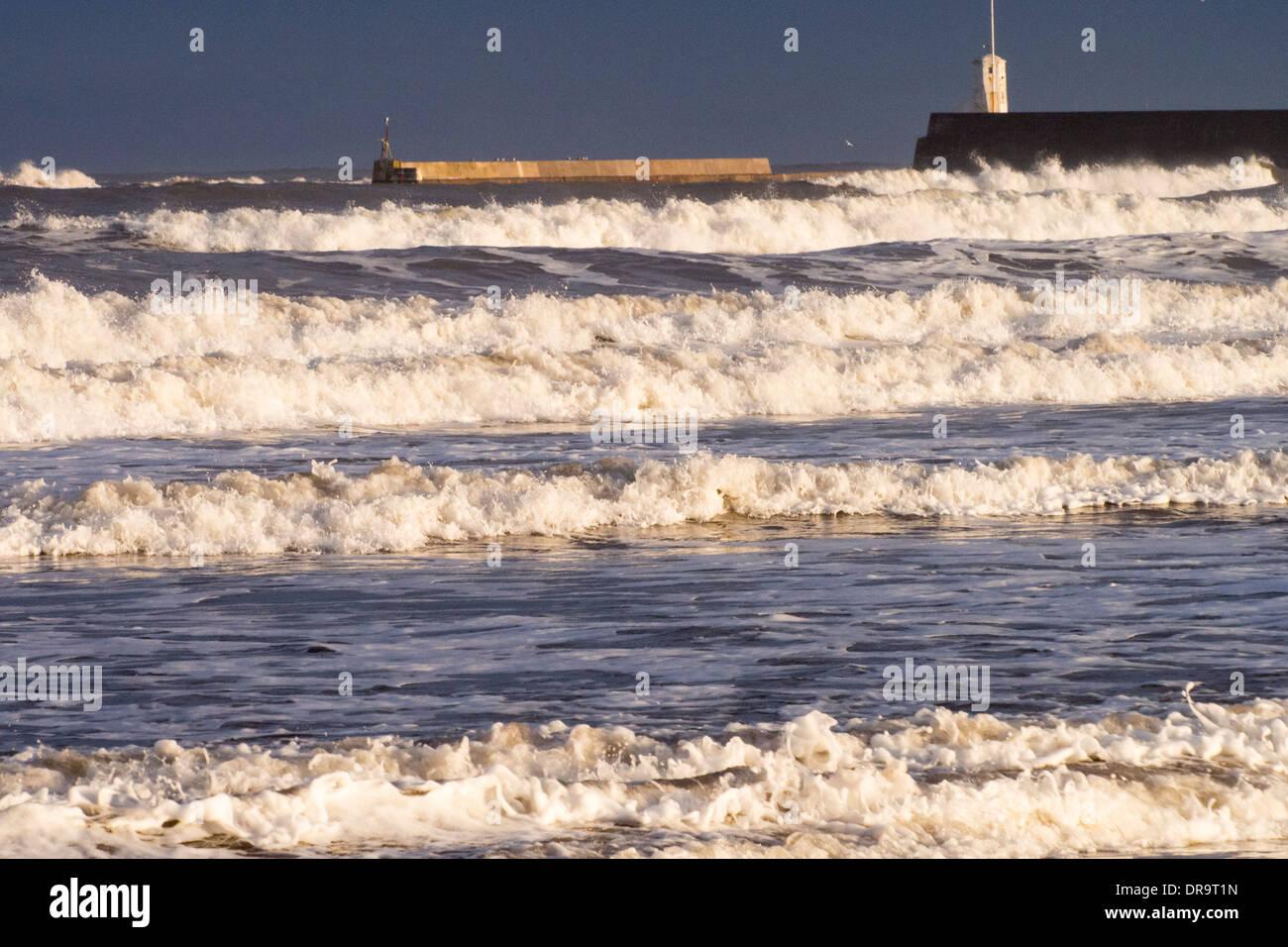 Waves hitting the Northumberland coast at Seahouses. - Stock Image