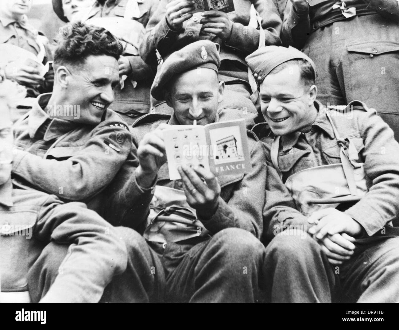 British troops reading French guide - Stock Image