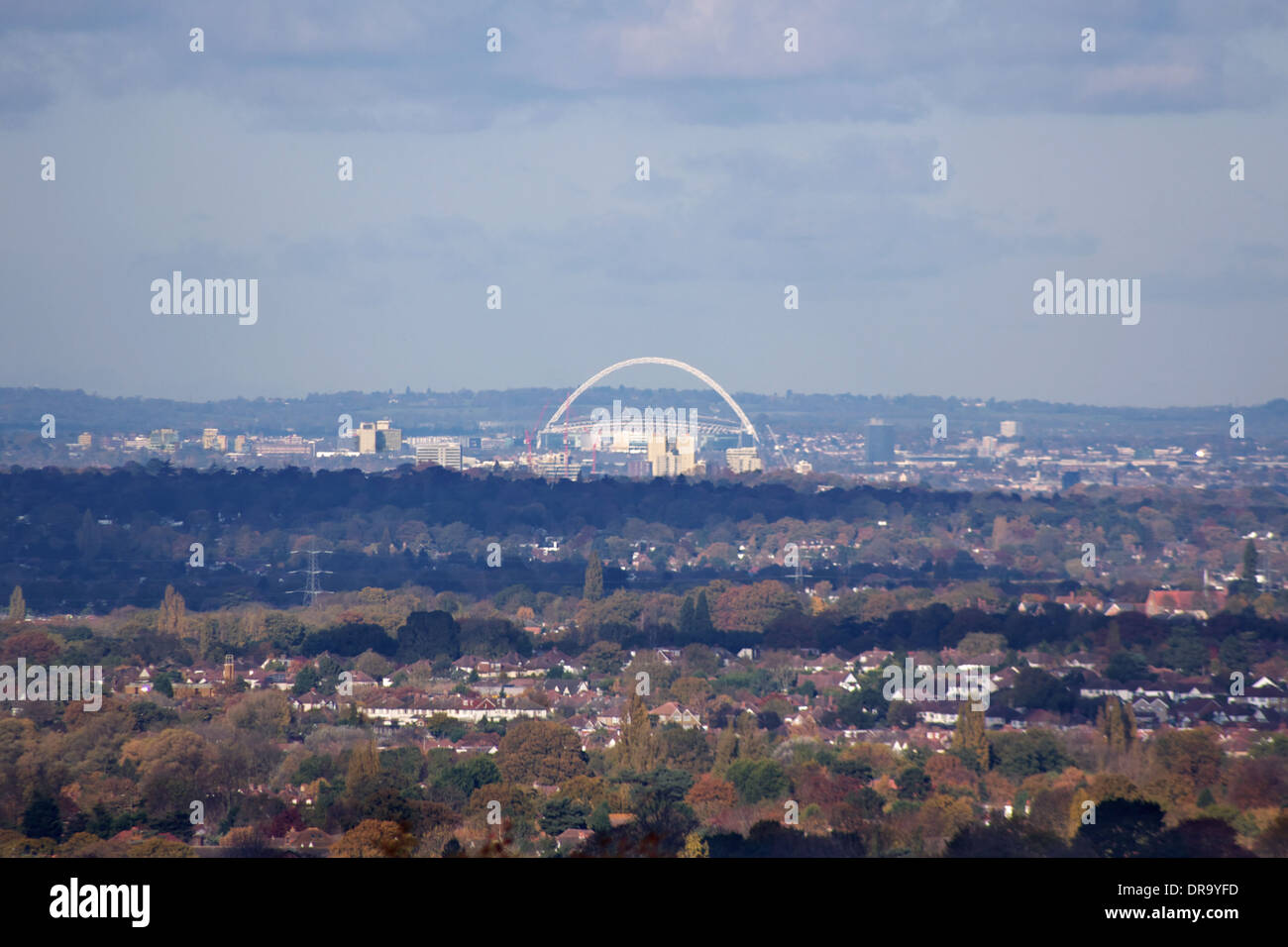 Wembley Stadium in London, with its distinctive arch, home of football in England, seen from Epsom Downs, 15 miles, 24km,  away. - Stock Image