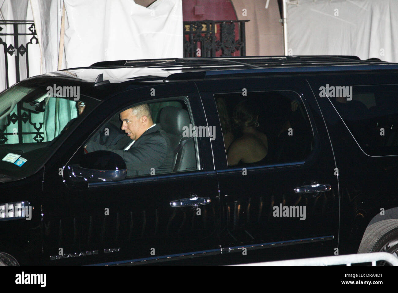 Security obscure the wedding car from view as Alec Baldwin and his new wife Hilaria Thomas leave their wedding service held at The Basilica of St. Patrick's Old Cathedral in Little Italy, Manhattan. New York City, USA - 30.06.12 - Stock Image