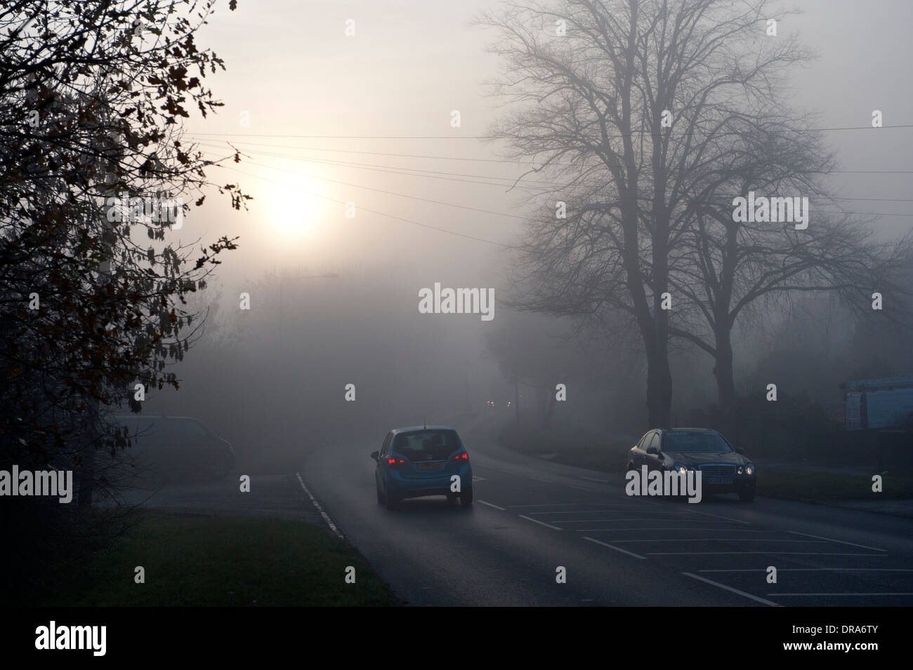Road traffic during a foggy morning - Stock Image
