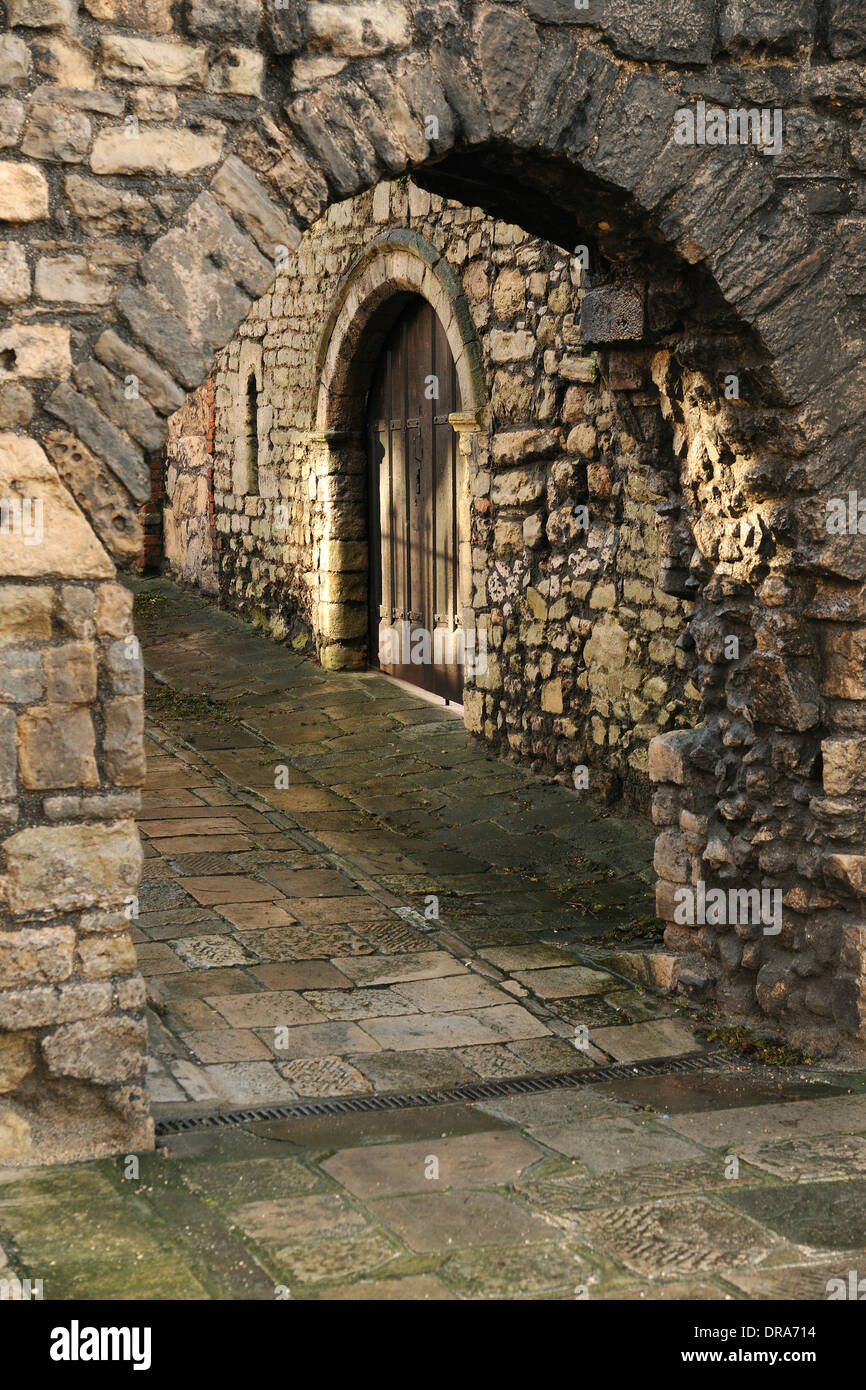 An archway leading through the historic old city walls of Southampton, Hampshire, England. - Stock Image