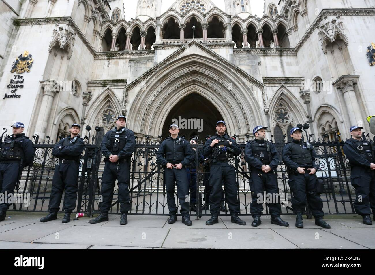 Police stand guard outside the Royal Courts of Justice. Students continued their campaign in support of lecturers and support staff pay and pensions as well as Police violence at recent student occupations in London. Around 150 students continued their campaign in support of lecturers and support staff pay and pensions as well as Police violence at recent student occupations. Demonstrators marched from the University of London Union (ULU) to the Royal Courts of Justice in central London. - Stock Image
