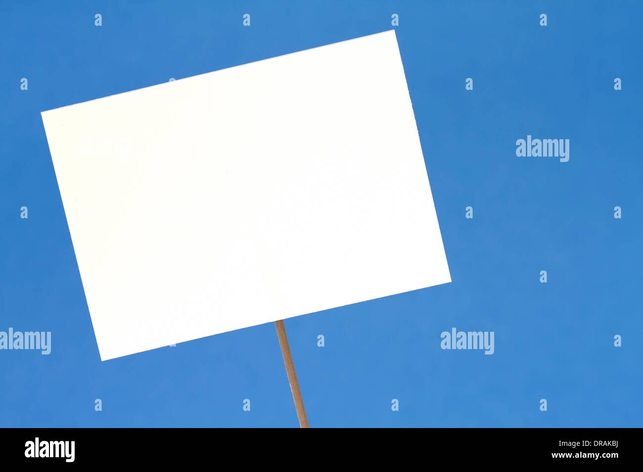 Blank white sign on a blue background - Stock Image