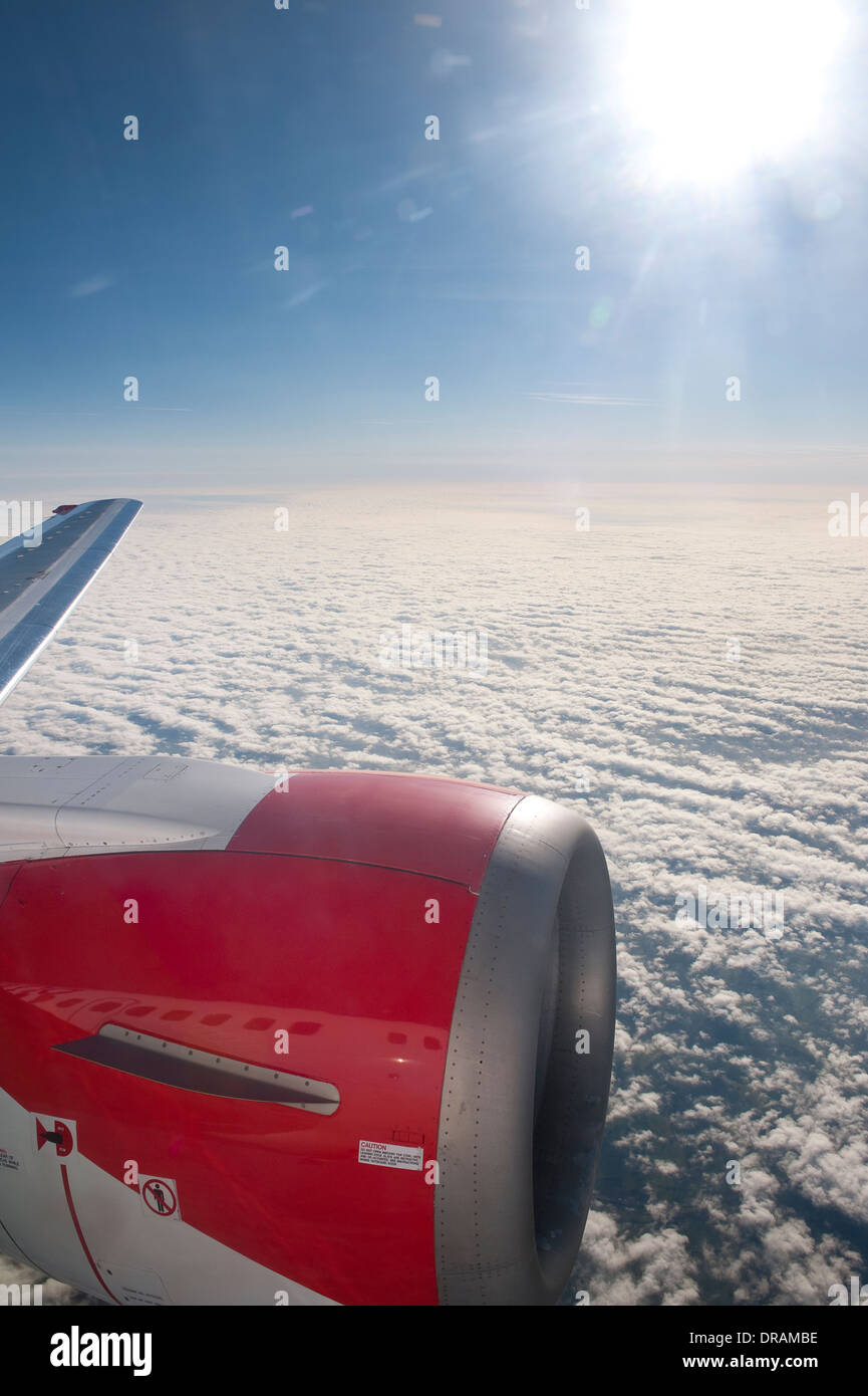 View through an aeroplane window whilst it is in flight. Stock Photo