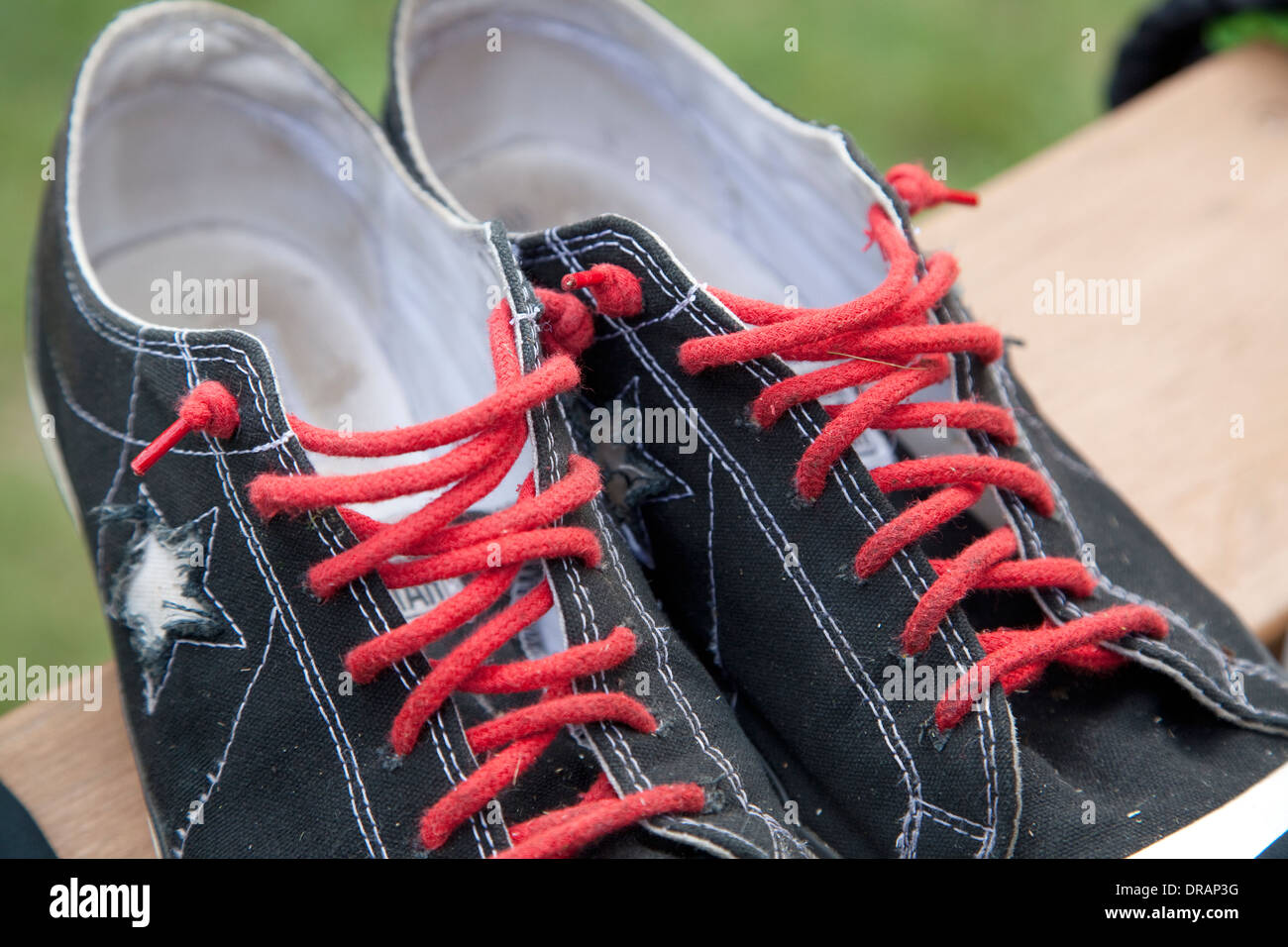 6def27c1af39 Pair of black Converse One Star low top sneaker shoes with red laces.  Battle Lake