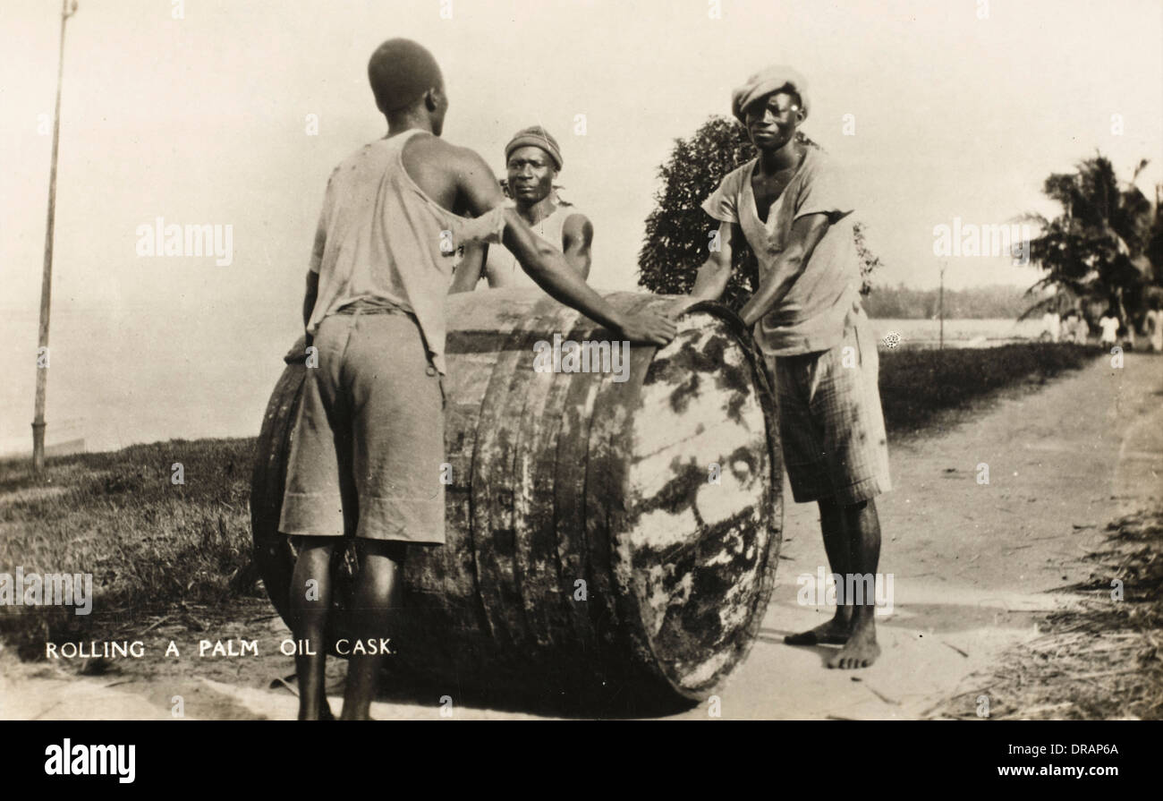 Rolling a Palm Oil Cask - Nigeria - Stock Image