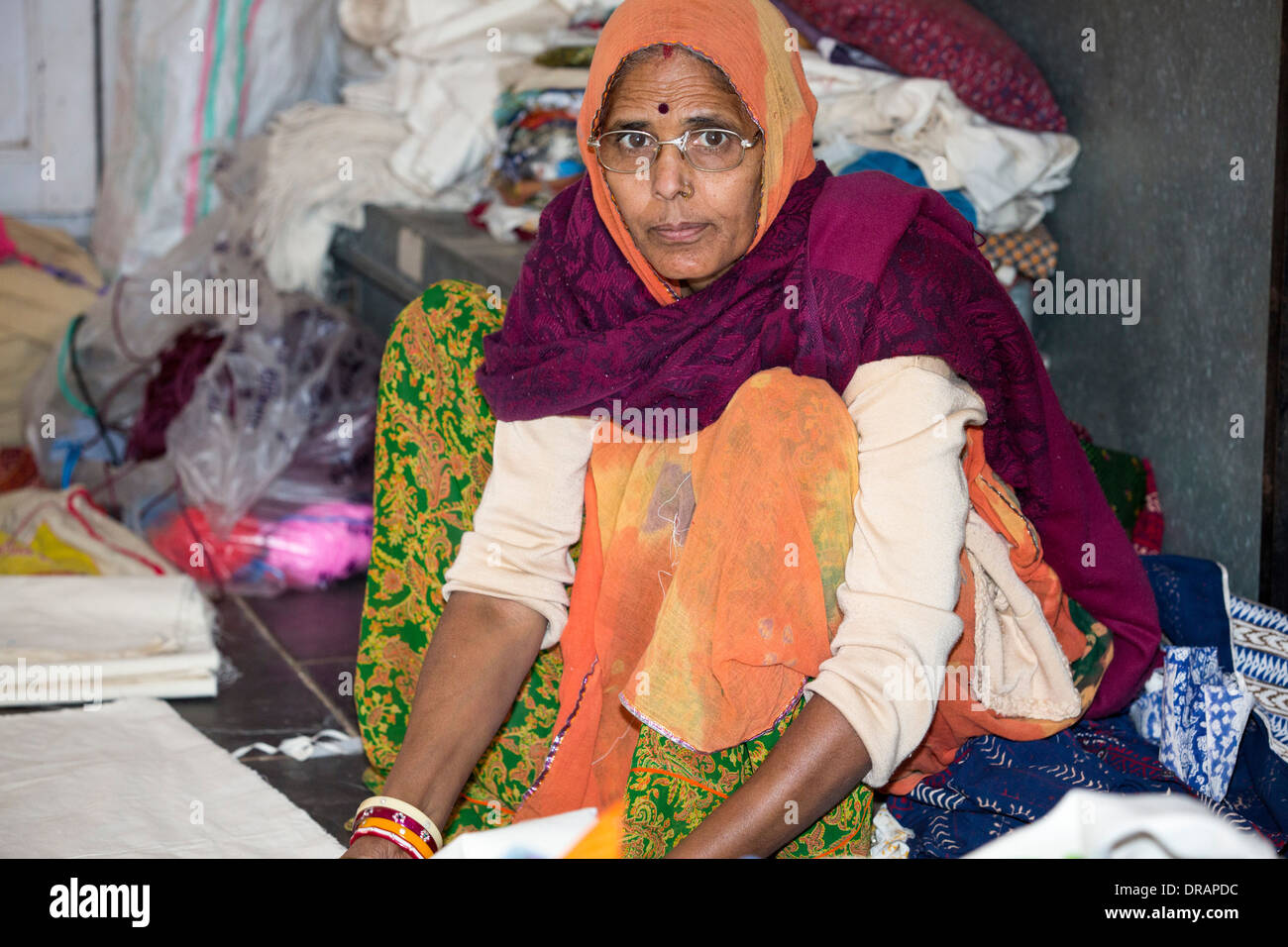 A disabled women sewing at the Barefoot College in Tilonia, Rajasthan, India. - Stock Image