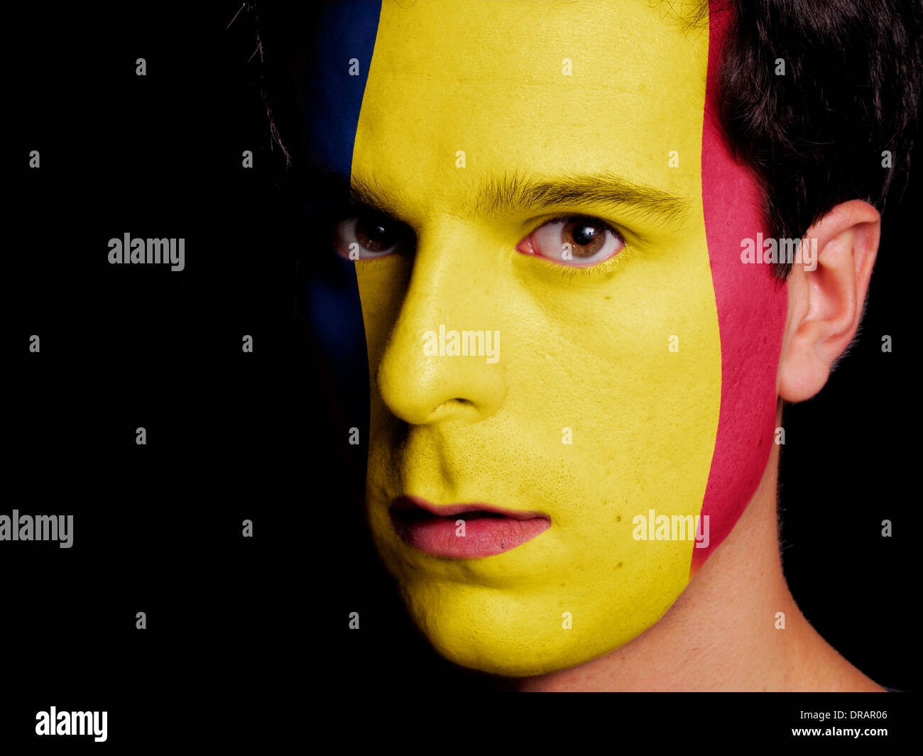 Flag of Chad Painted on a Face of a Young Man - Stock Image