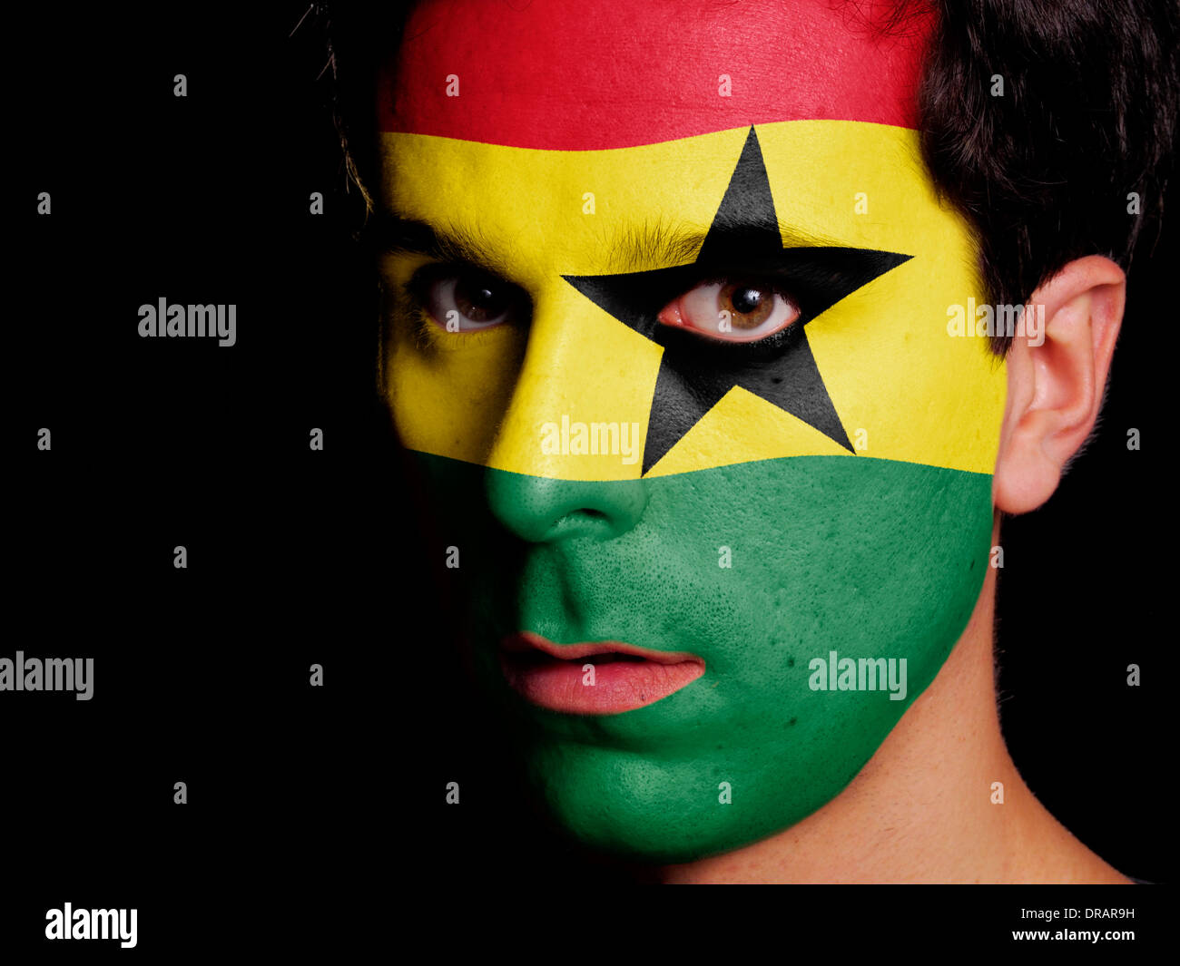 Flag of Ghana Painted on a Face of a Young Man Stock Photo