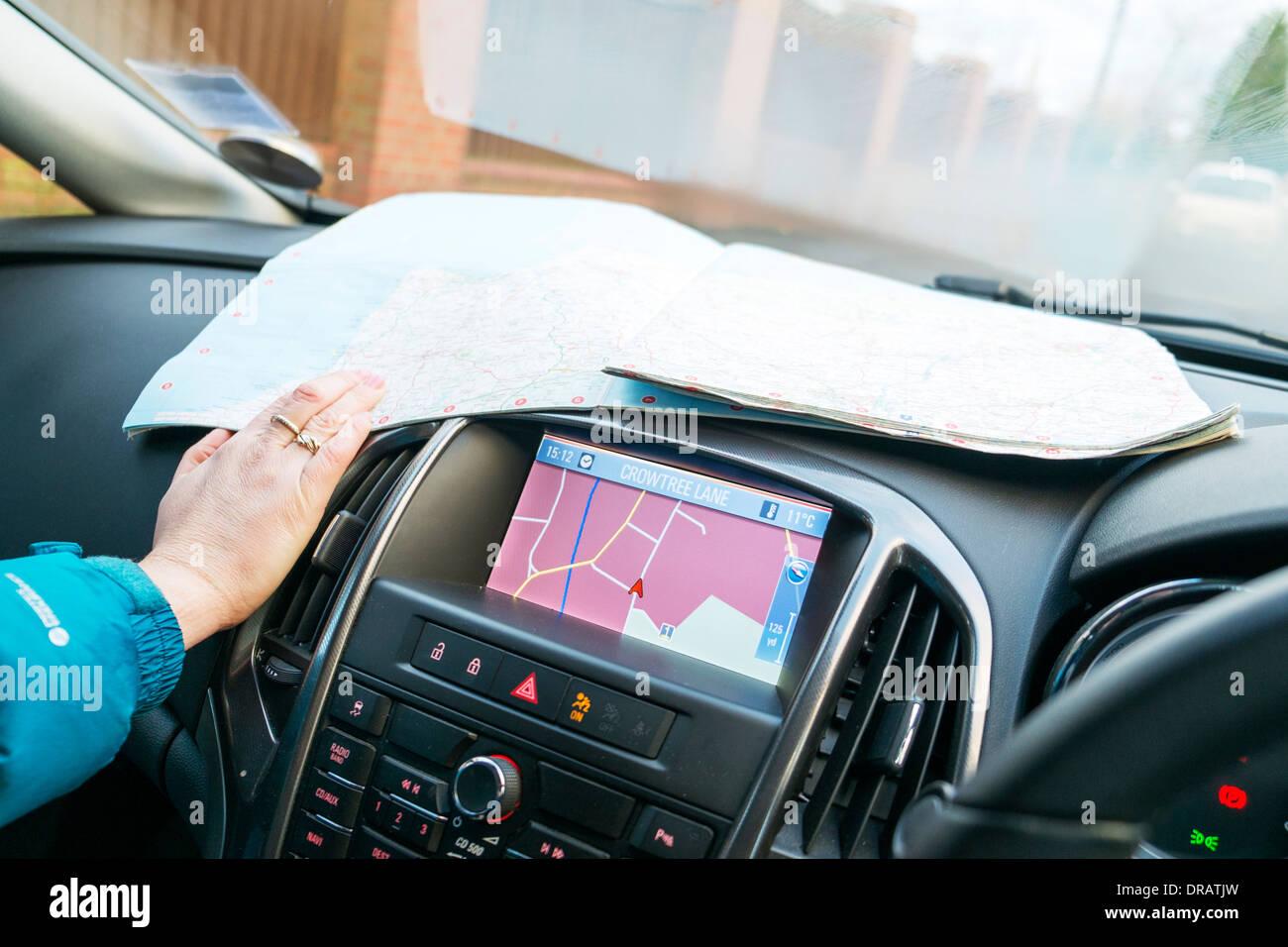 map versus sat nav satnav navigation print technology satellite navigation best better quicker route find finding quickest - Stock Image