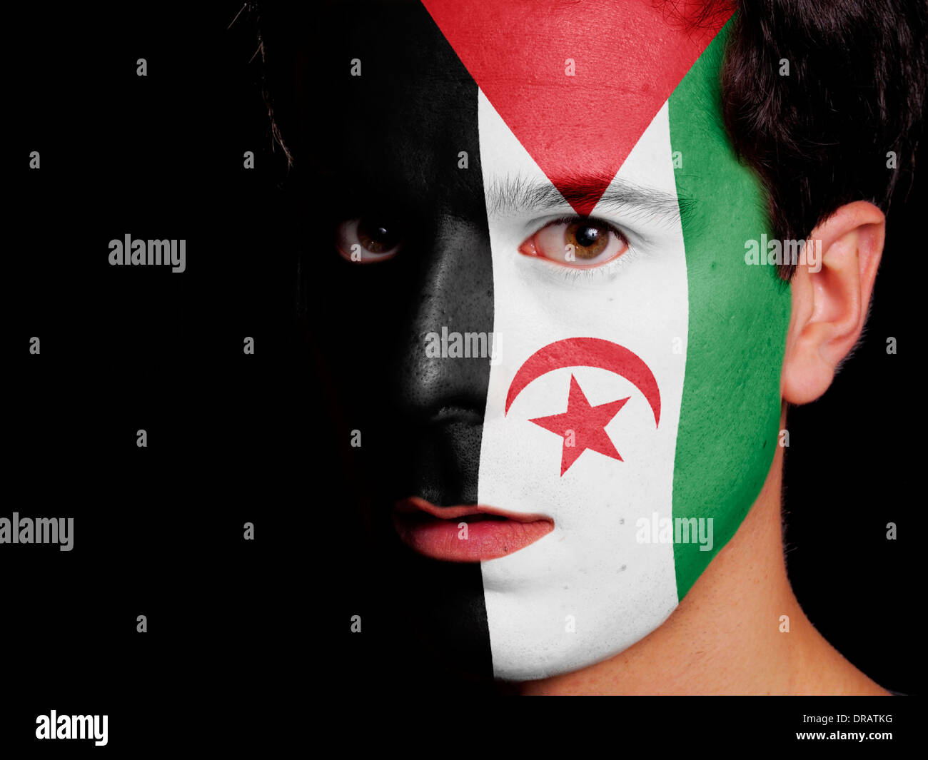 Flag of Sahrawi Arab Democratic Republic Painted on a Face of a Young Man - Stock Image