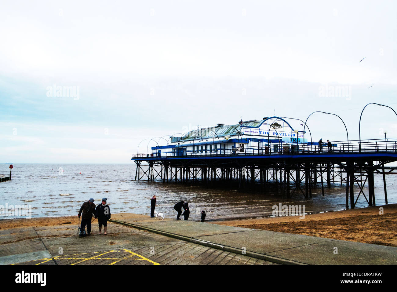 Cleethorpes pier outside exterior coast sea seaside attraction, and slipway Lincolnshire coastal, UK, England - Stock Image