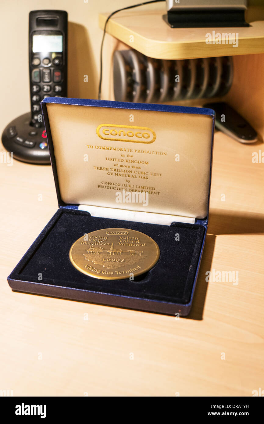 Conoco fuel commemorative coin to commemorate production in UK of 3 trillion cubic feet of natural gas - Stock Image