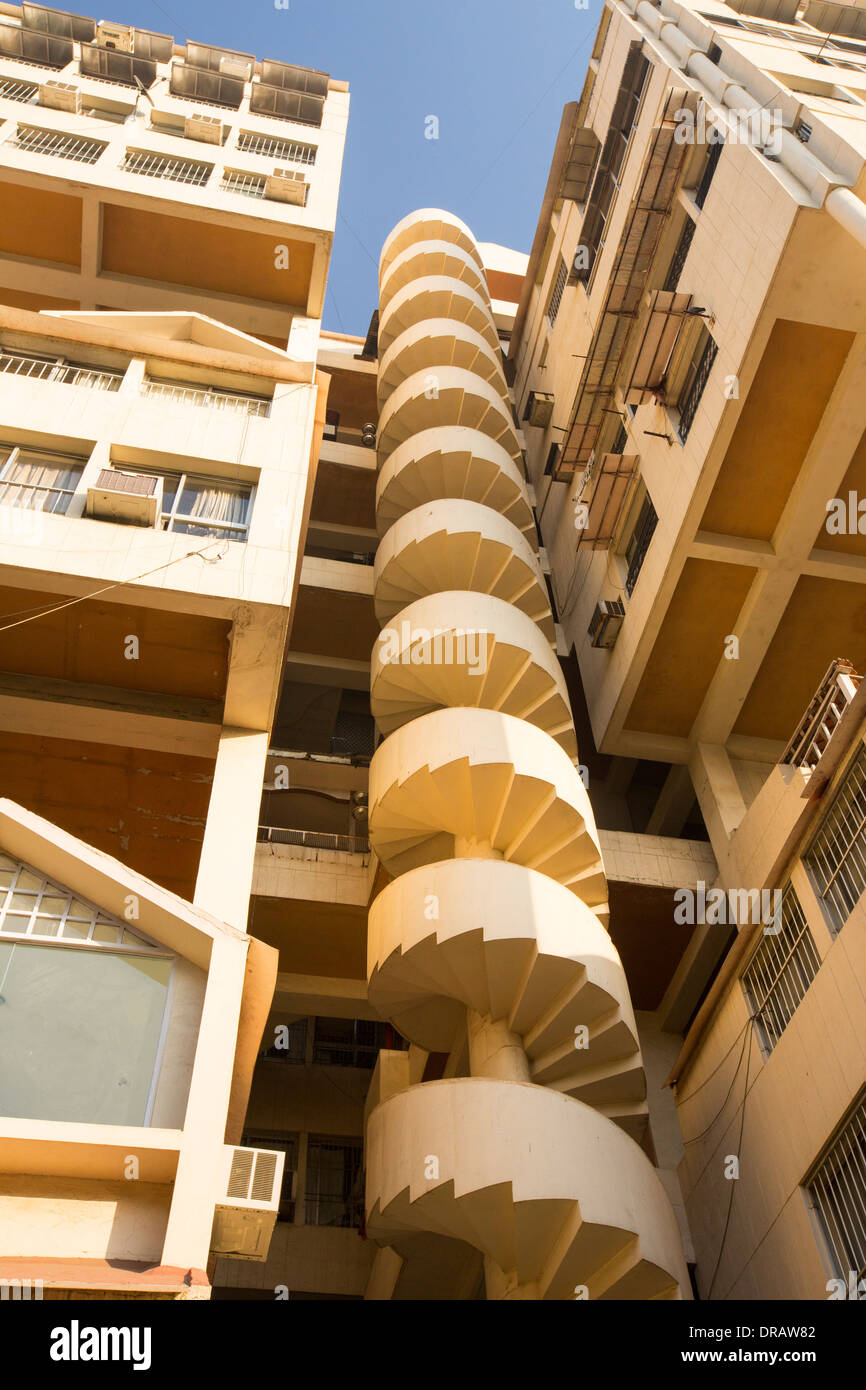 An apartment block with a spiral staircase in Ahmedabad; India. - Stock Image