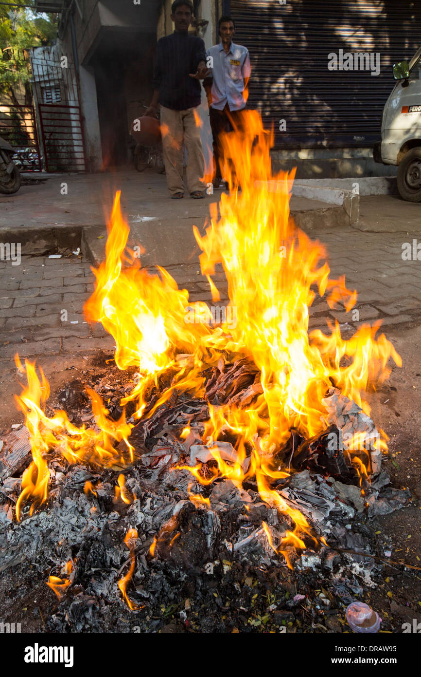 Burning rubbish on the streets of Ahmedabad; India. - Stock Image