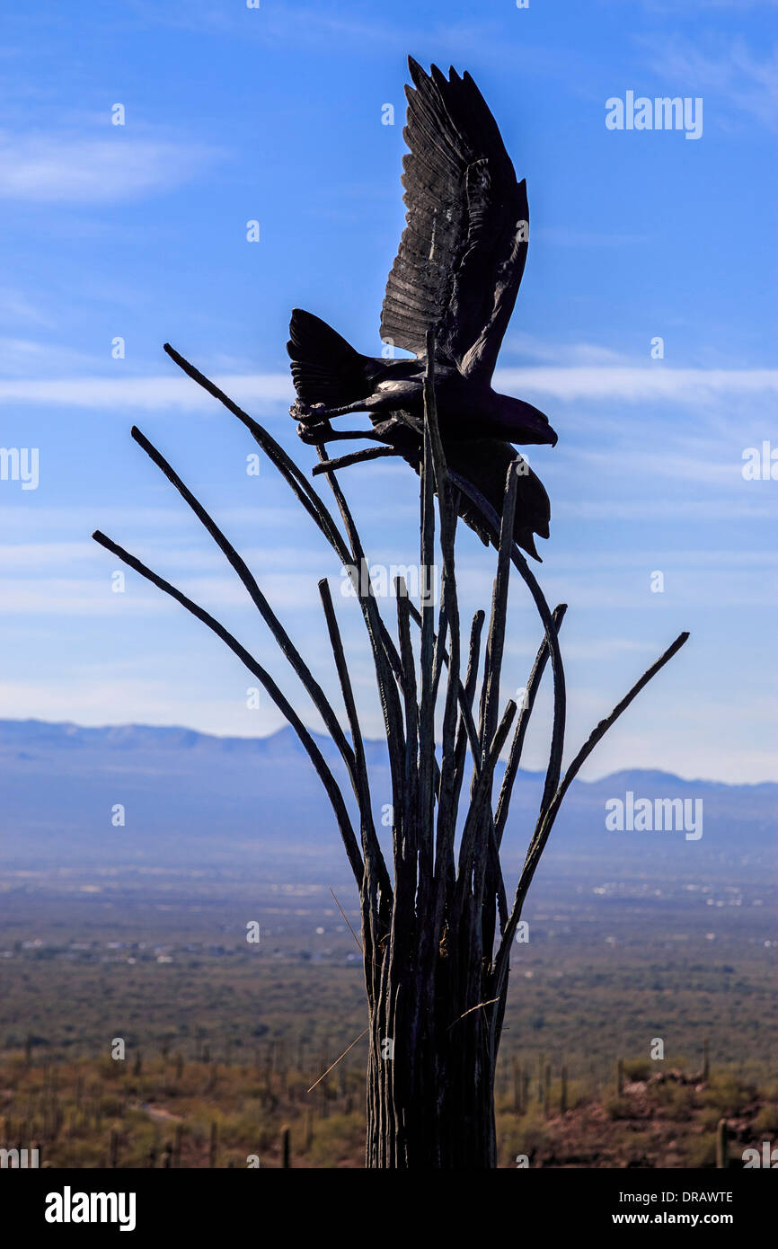 Metal sculpture of eagle flying over skeletal remains of a saguaro cactus, artwork at the Arizona Sonora Desert Museum - Stock Image