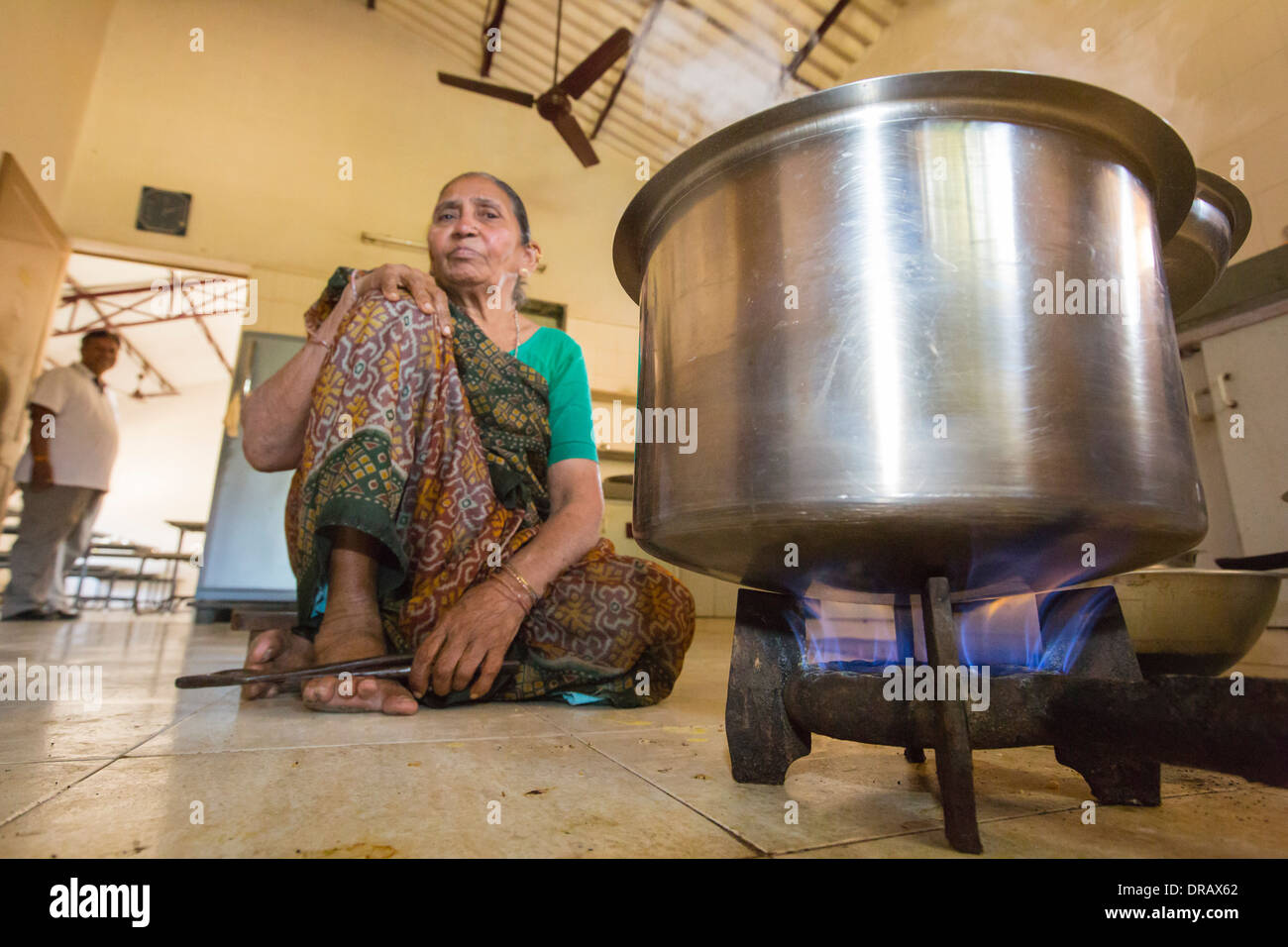 staff in the old folks home kitchen cooking using biogas generated in the grounds. - Stock Image