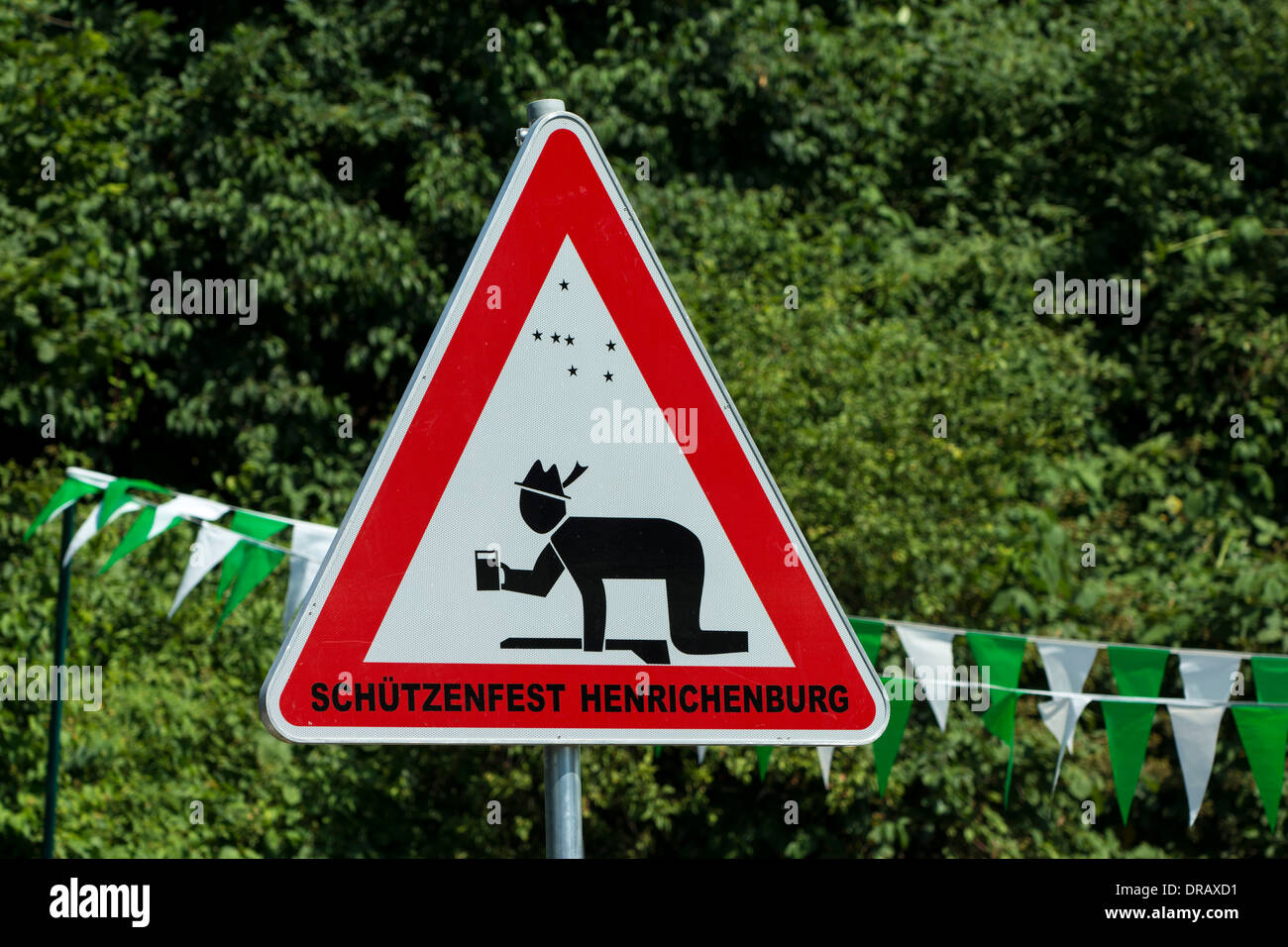 A traffic sign asks for consideration for visitors of a nearby marksmen's festival who might be under the influence of alcohol. - Stock Image