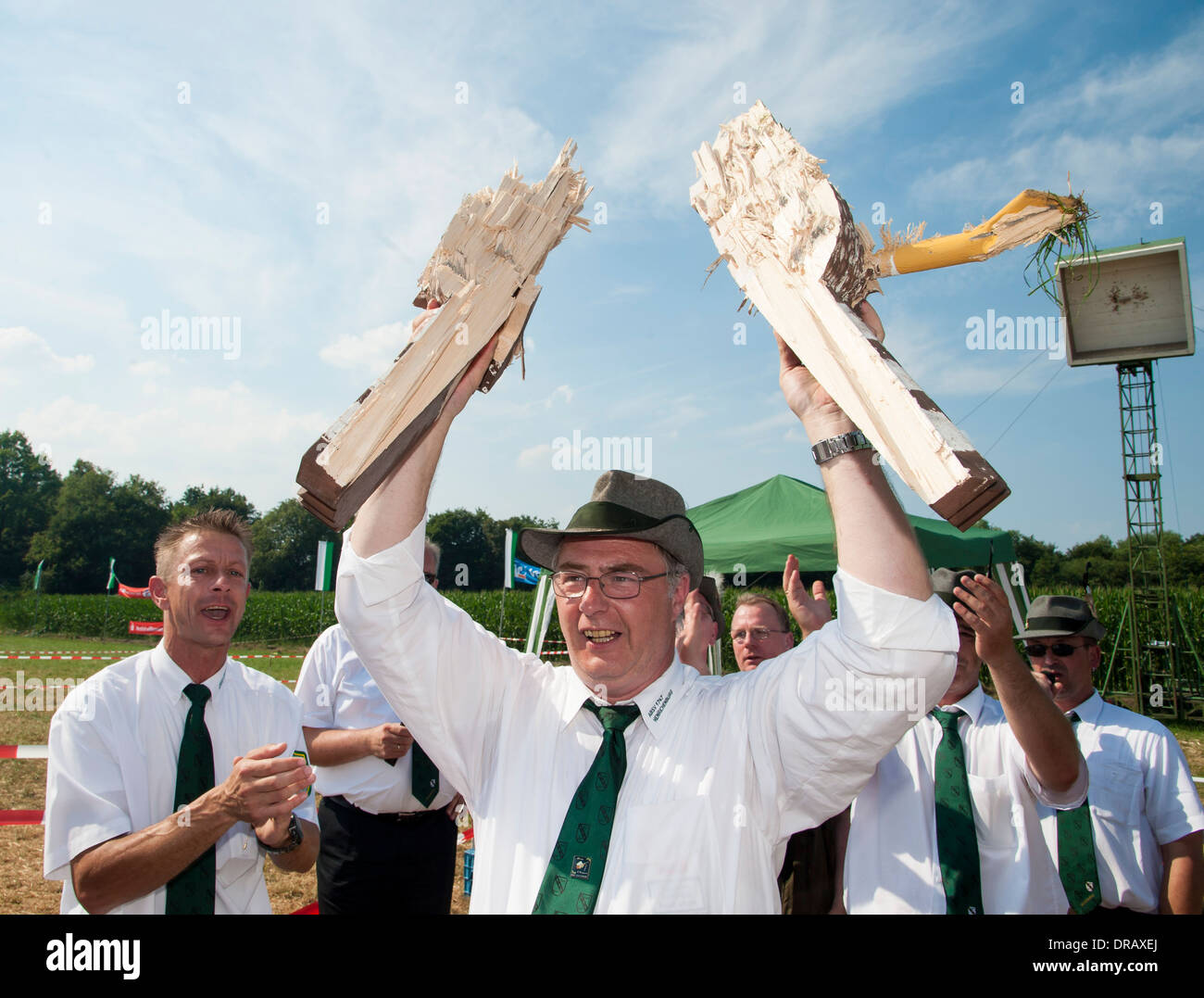 Shooters applaud their new shooters king, in the middle, who shot the wooden shooters bird down at the marksmen's festival. - Stock Image