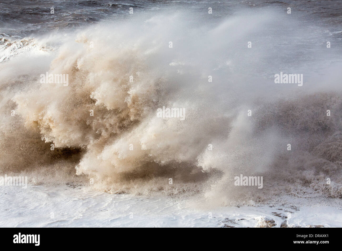 Waves crashing off Whitehaven harbour during the January 2014 period of storm surge, high tides and storm force winds. - Stock Image