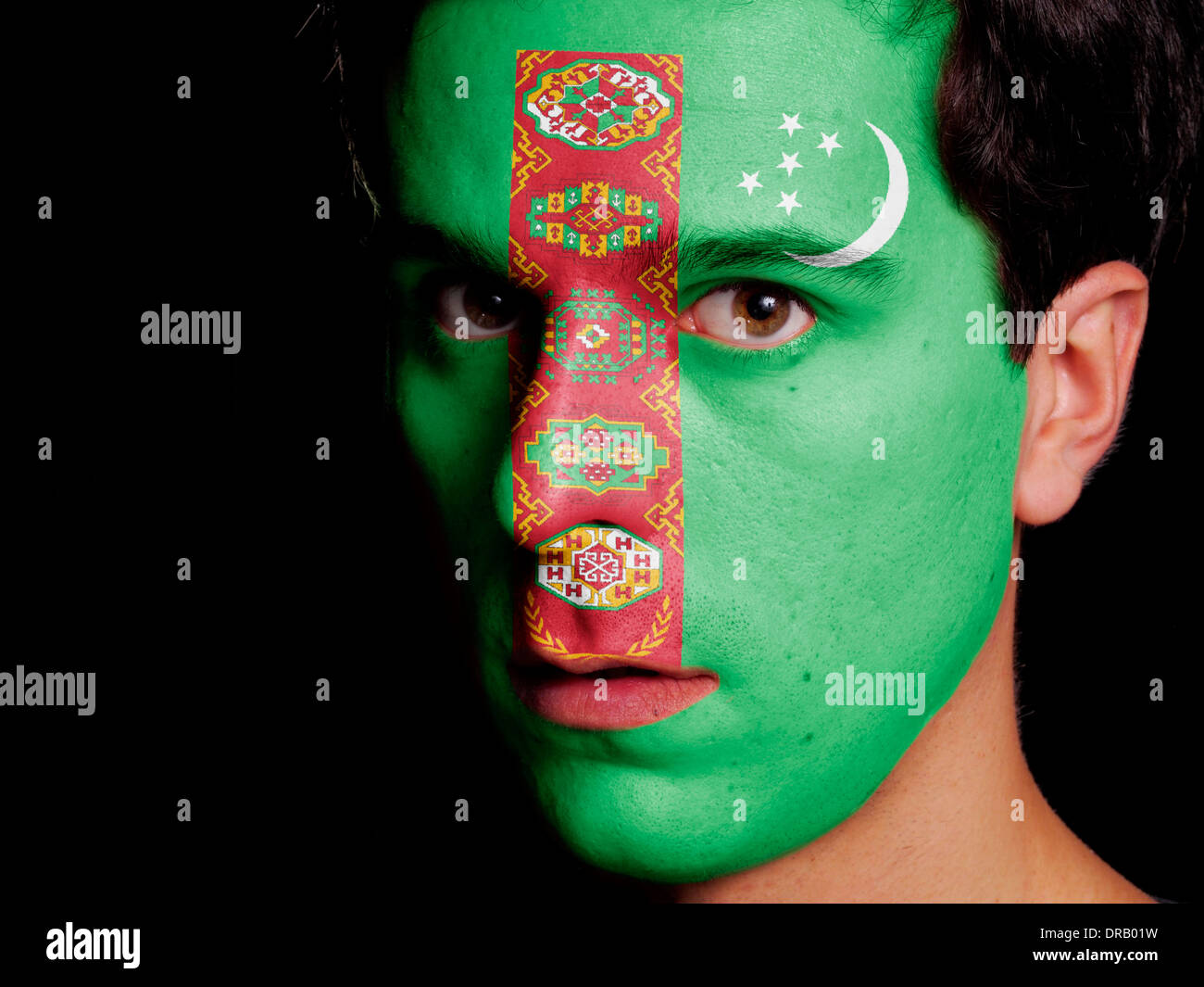 Flag of Turkmenistan Painted on a Face of a Young Man - Stock Image
