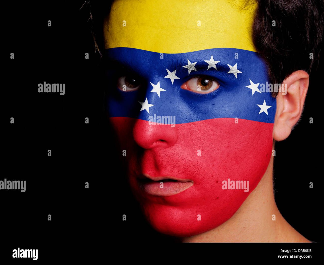 Flag of Venezuela Painted on a Face of a Young Man - Stock Image