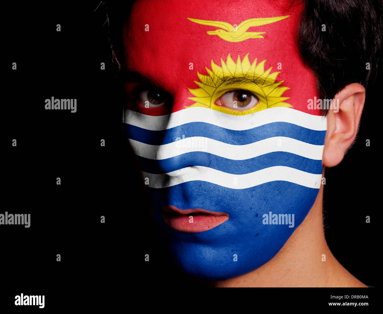 Flag of Kiribati Painted on a Face of a Young Man - Stock Image