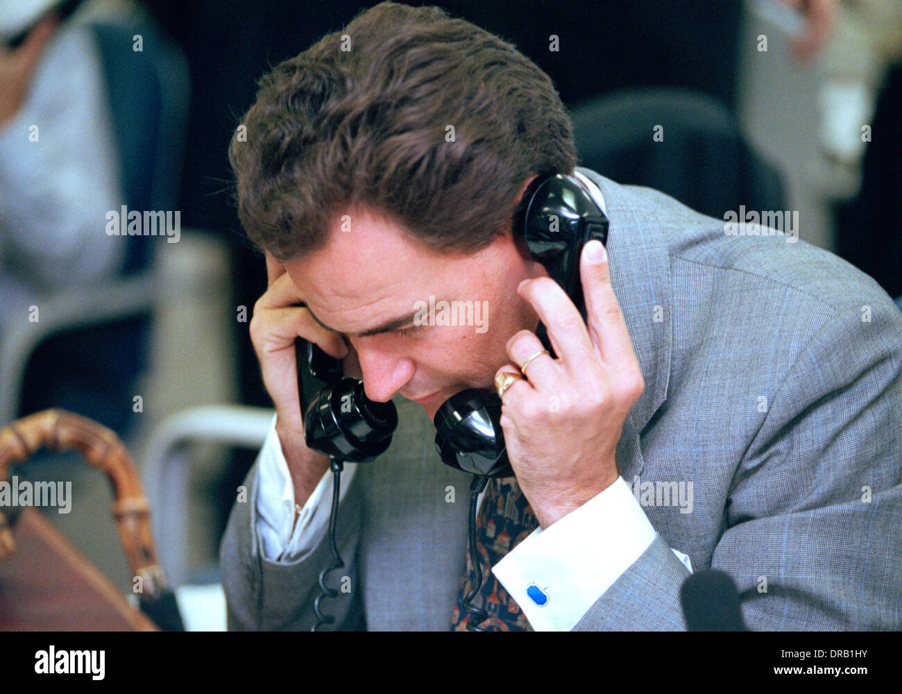 A London City trader at work making deals, at his desk in an Investment Bank in the 1990's Stock Photo