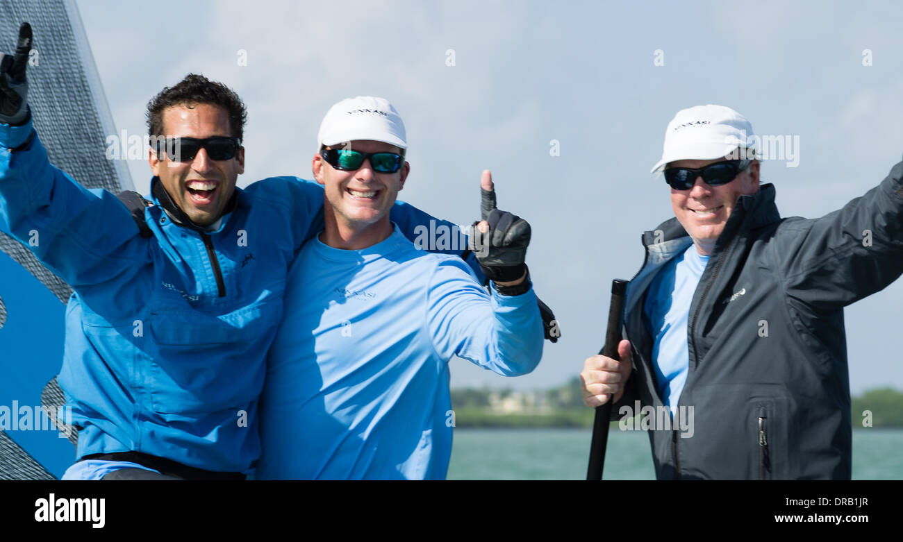 Key Largo, USA, December 17, 2013 - Ninkasi's crew upon hearing that they'd won the first Melges 20 World Championships.  From left to right  Joey Mello (Headsail Trimmer); Bill Hardesty, Trimmer; and John Taylor, Owner/Helmsman. - Stock Image