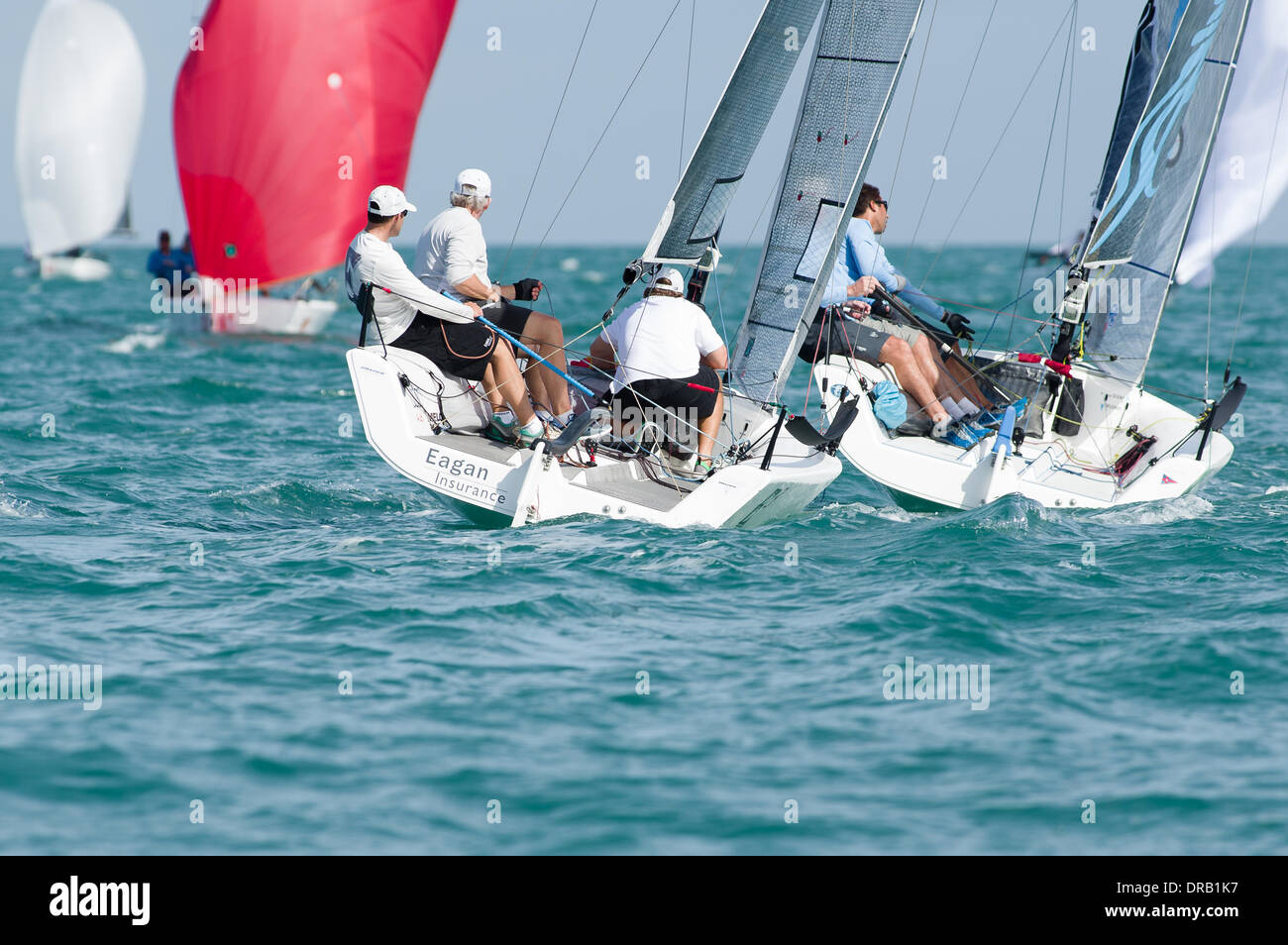 Key Largo, FL, USA, December 12, 2013 - Cajun Underwriting, skippered by Marcus Eagan, covers John Taylor's Ninkasi after a close mark rounding.  Taylor won the regatta and Eagan earned 3rd overall as well as 1st in the Corinthian division. - Stock Image