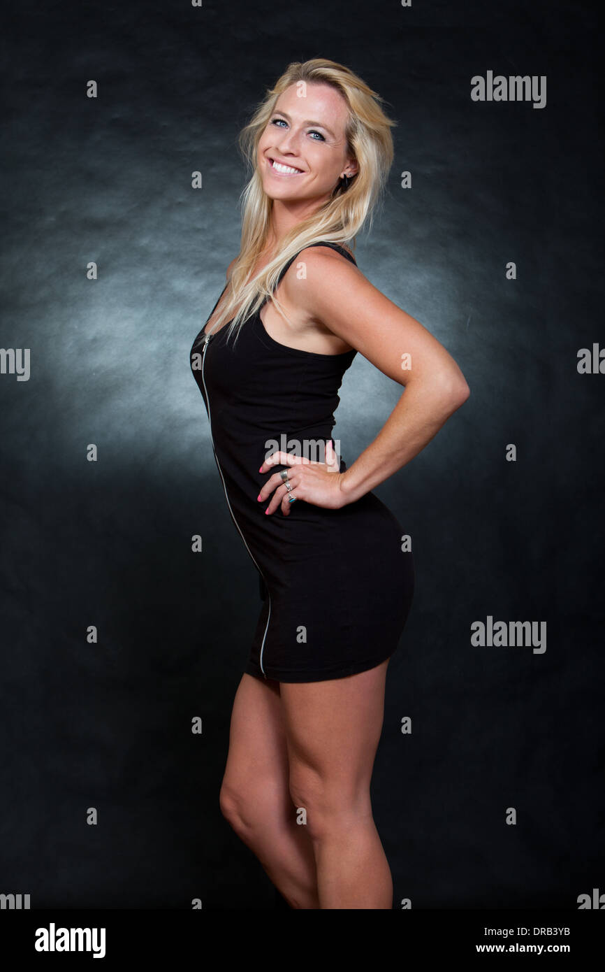Pretty blond caucasian fashion woman - Stock Image