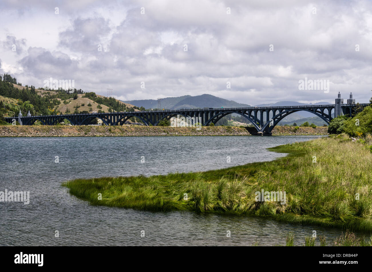 Isaac Lee Patterson bridge across the Rogue River with cloudy sky.  Gold Beach. Oregon - Stock Image
