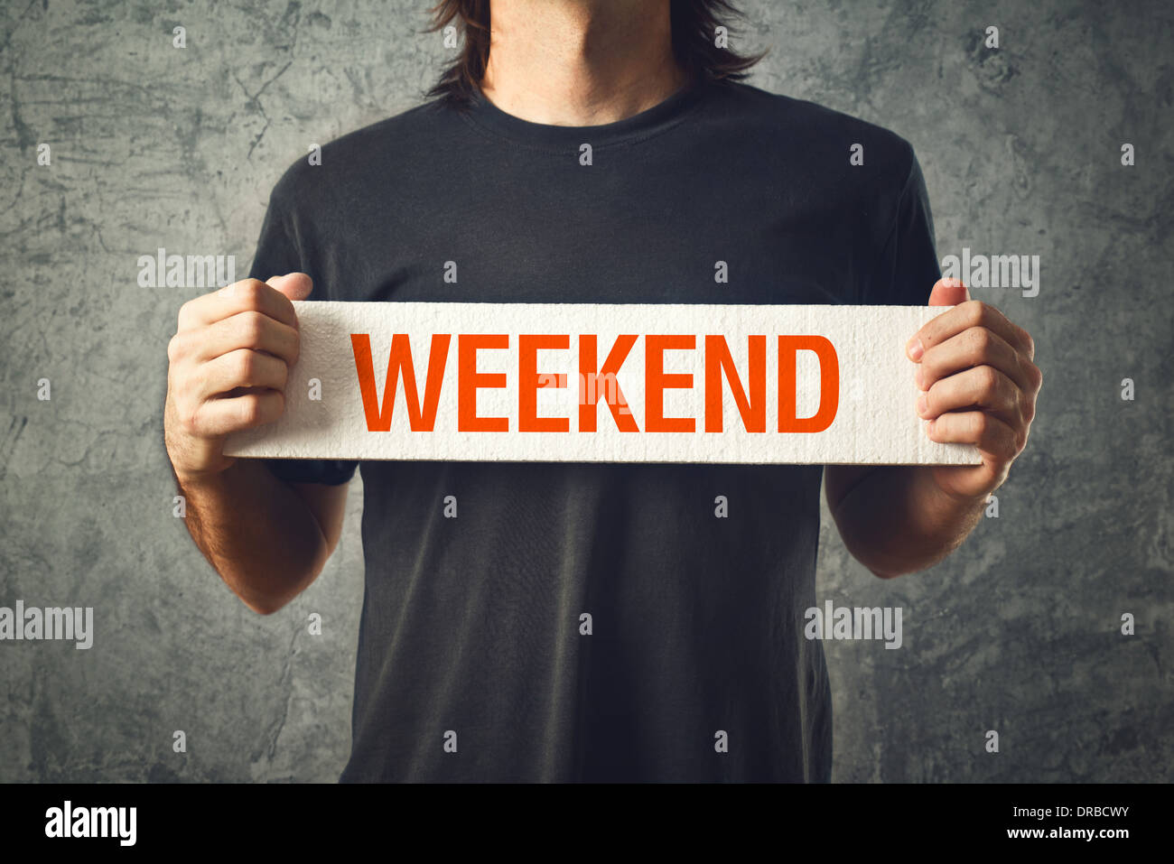 Man holding board with WEEKEND title. Interlude concept. - Stock Image